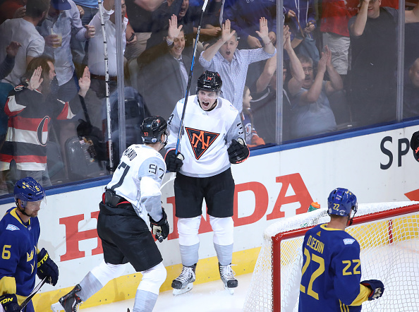 We'll probably never see Connor McDavid (left) and Auston Matthews celebrate a goal together again like they did in the first minute Wednesday against Sweden (Getty Images).