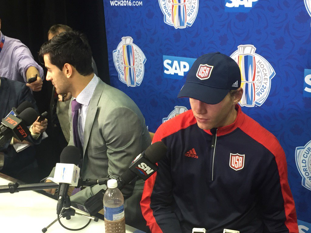 A somber Patrick Kane (right) and Max Pacioretty dissect Team USA's loss Tuesday night (Mike Harrington/Buffalo News).