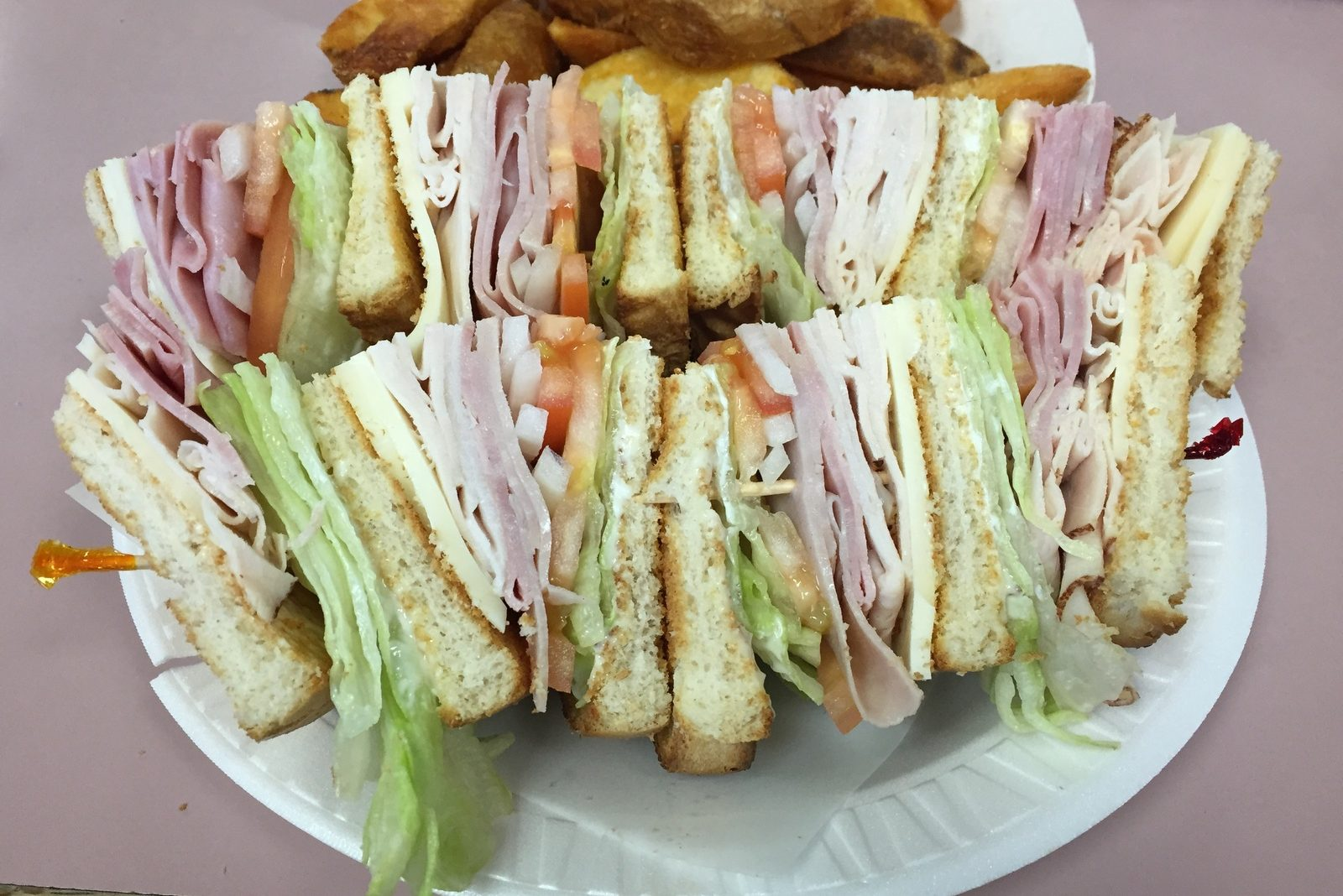 Club sandwich and potato wedges at Mayback's Deli. (Caitlin Hartney/Special to The News)