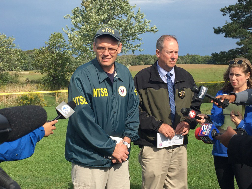 National Transportation Safety Board investigator Robert J. Gretz and Erie County Sheriff Det. Capt. Greg Savage spell out the investigation and identify the victims at the scene of the fatal North Collins plane crash on Monday morning. (Karen Robinson/Buffalo News)