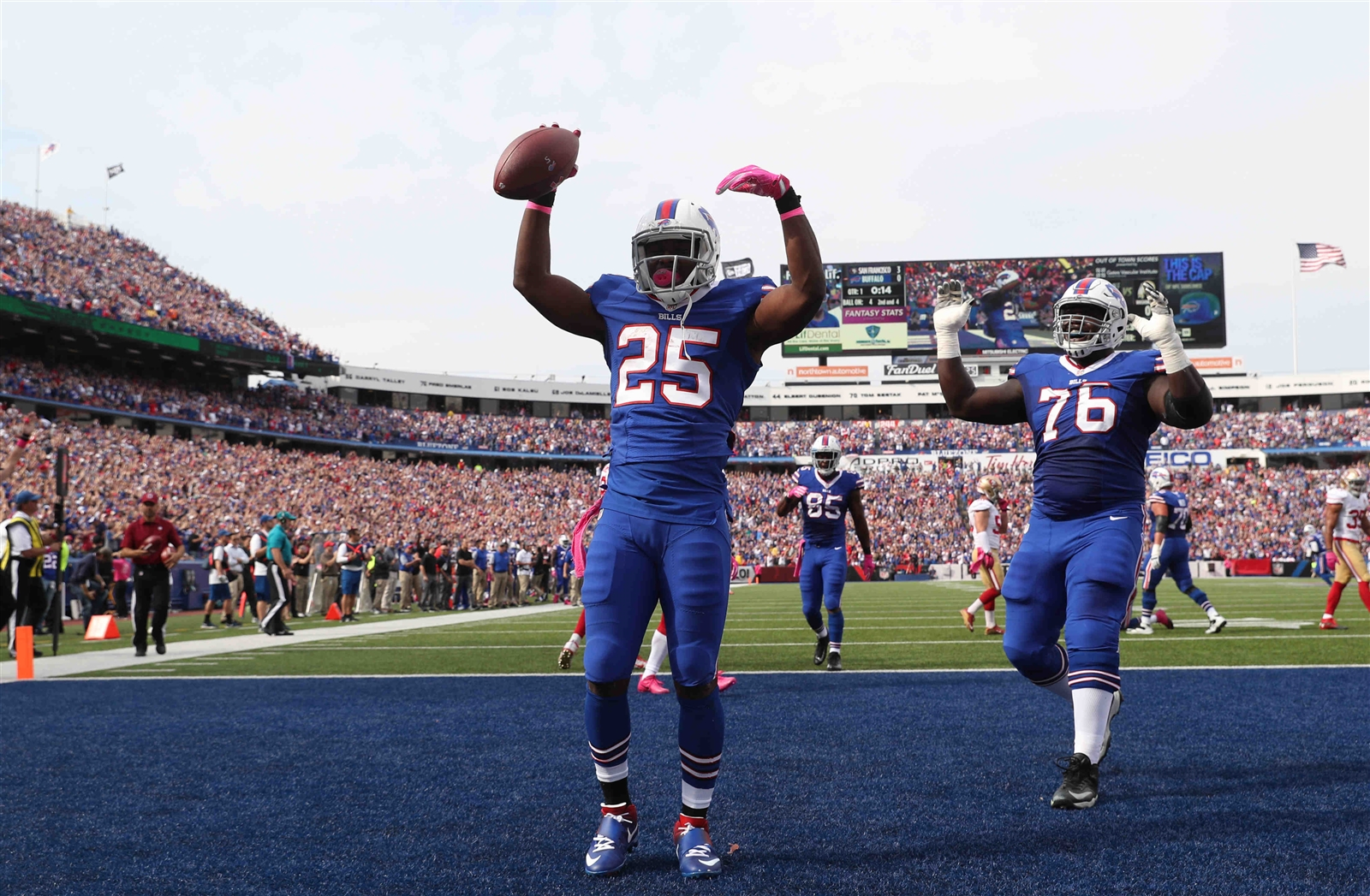 LeSean McCoy celebrates the first of his three touchdowns. (James P. McCoy/Buffalo News)