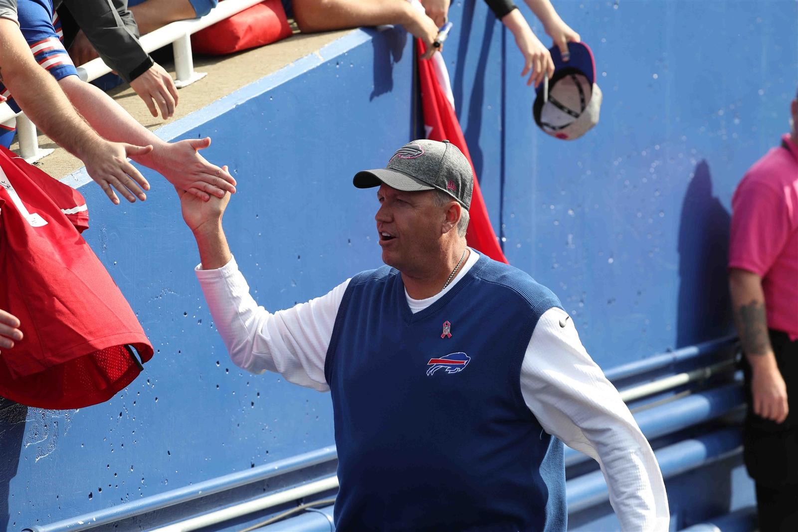 Rex Ryan greets Bills fans as he enters the field to face San Francisco. (James P. McCoy/Buffalo News)