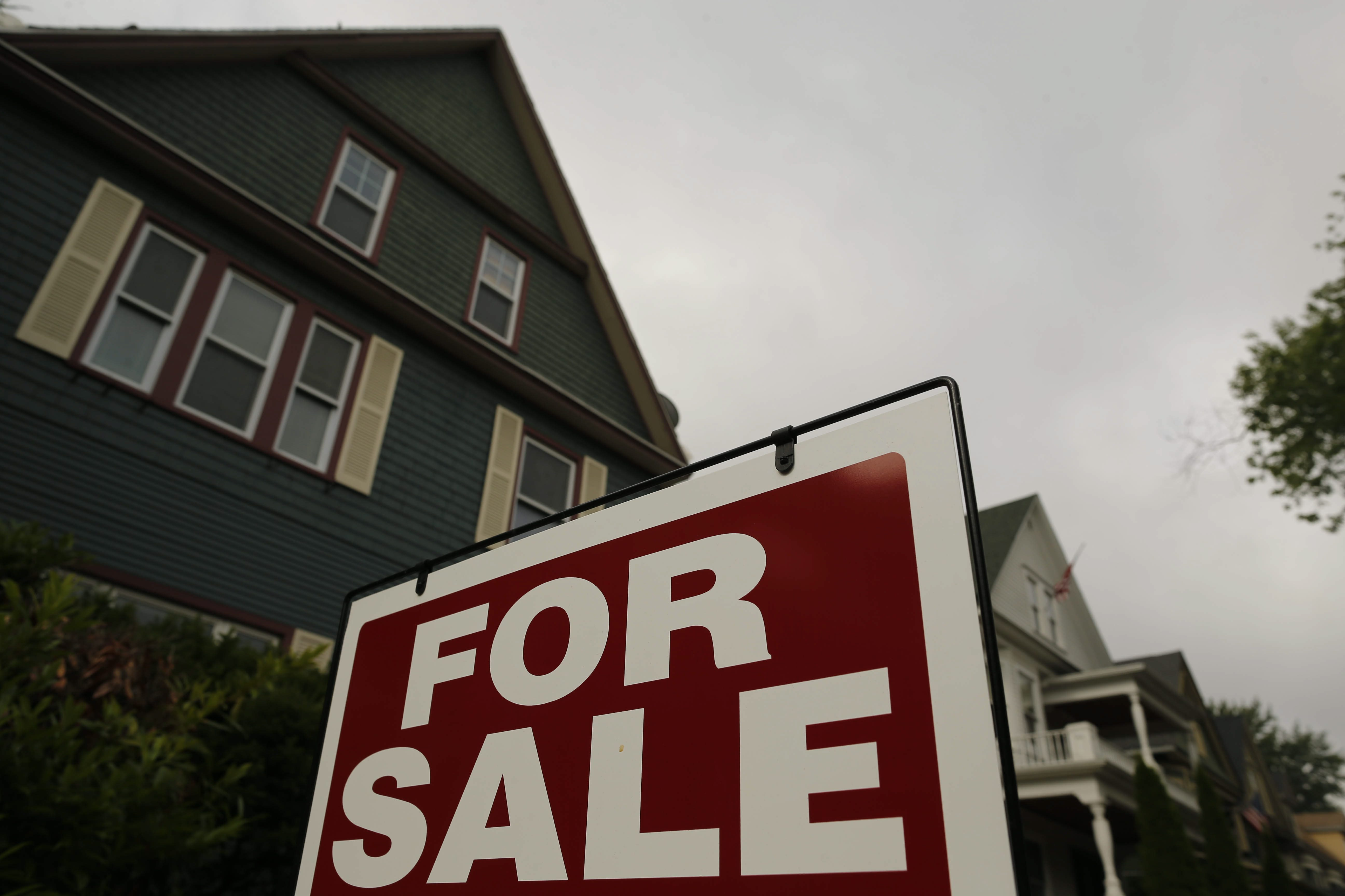 A 'for sale' sign sits in front of a home on Lafayette Avenue in Buffalo in 2016.  (Derek Gee/News file photo)