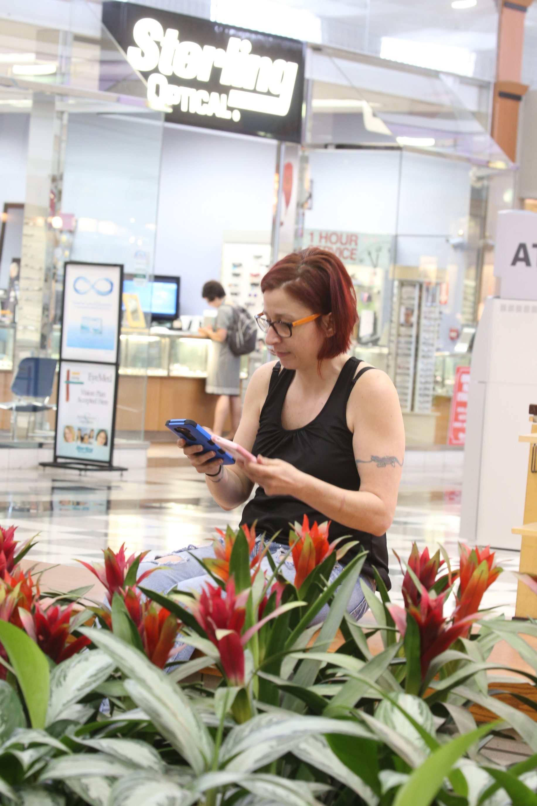 The Pokemon Go craze over the summer was a boon for the mall. Here Kim Giddings-Aravinthan of Amherst is on the hunt. (John Hickey/Buffalo News)