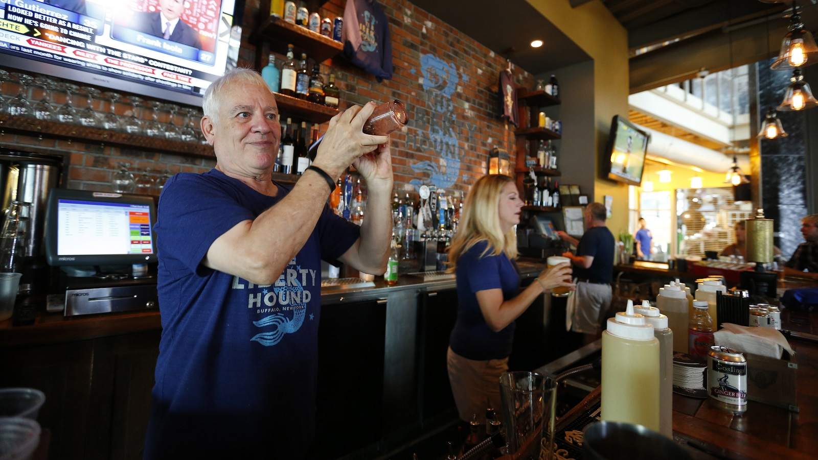Marty Loesch mixes a drink at the Liberty Hound in Buffalo Thursday, August 24, 2016.       (Mark Mulville/Buffalo News)
