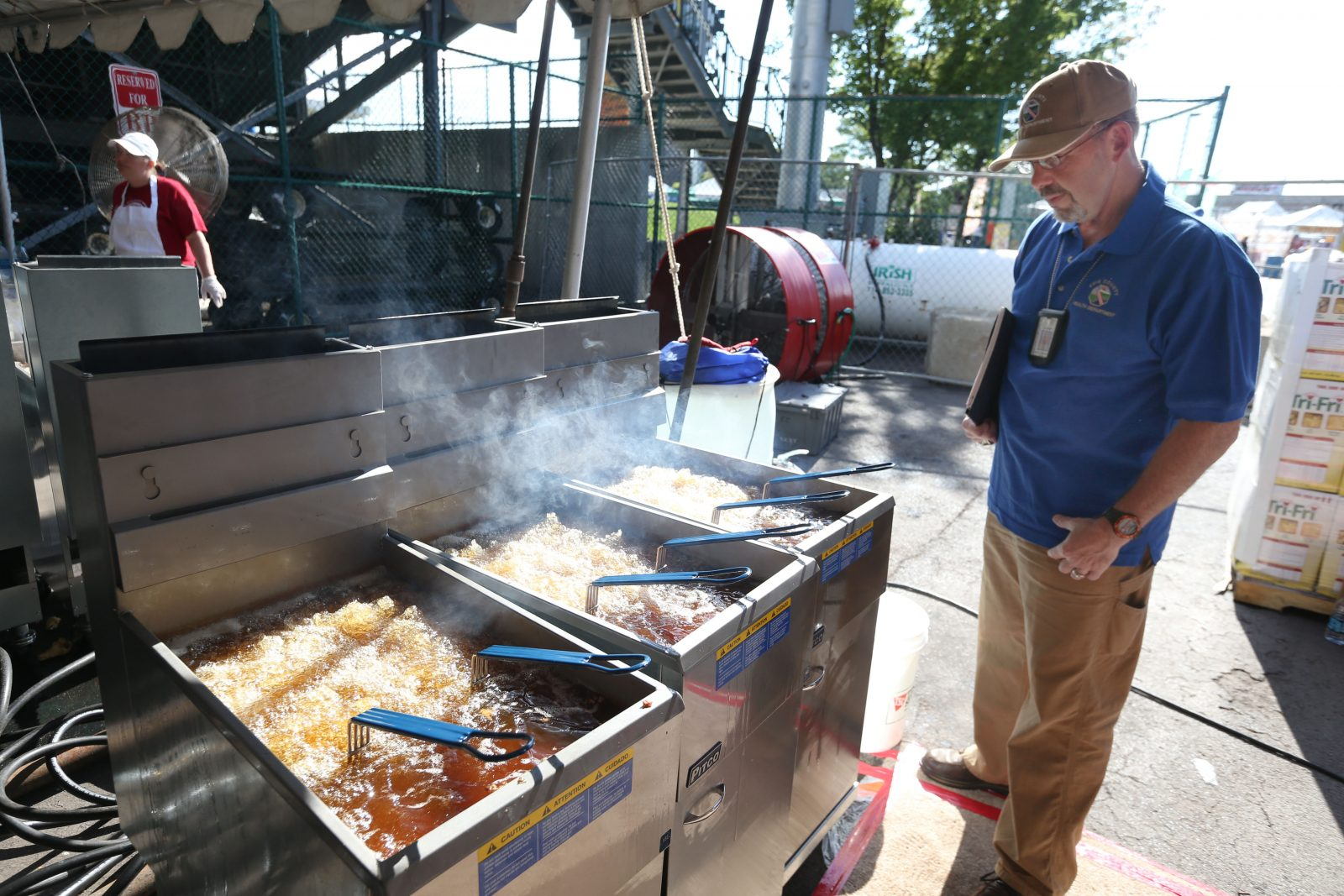 The Erie County Department of Health conducts food inspections at all the area festivals.  They inspect the operations at the Buffalo Wing Festival, Saturday, Sept. 3, 2016. Inspector Daniel Thibodeau hangs around the area where the wings are cooked during the morning before the festival opens.  He observes the operation, looks at the condition of the equipment and takes temperatures of various batches of wings to be sure of consistently safe temperatures of cooked wings.  Here, he observes the operation. (Sharon Cantillon/Buffalo News)