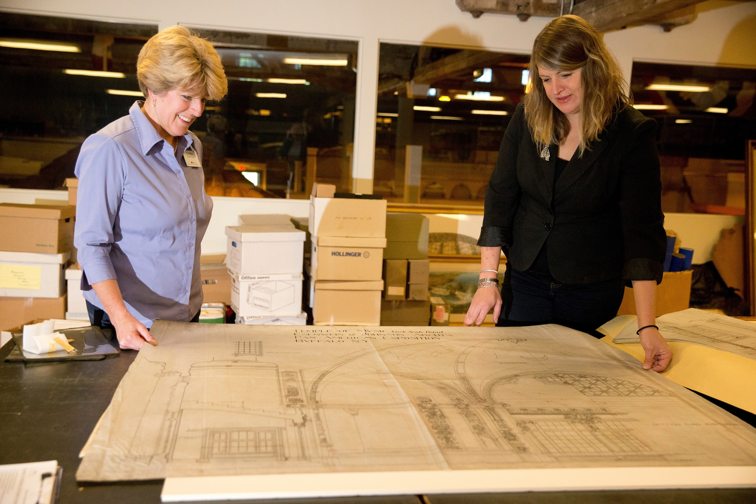 Cynthia Van Ness, director of library and archives, left, and Melissa Brown, executive director of the Buffalo History Museum, look at wax linen prints of the Temple of Music dome from the Pan-American Exposition at the Buffalo History Museum, Resource Center, in Buffalo, on Thursday, Sept. 15, 2016.  (John Hickey/Buffalo News)