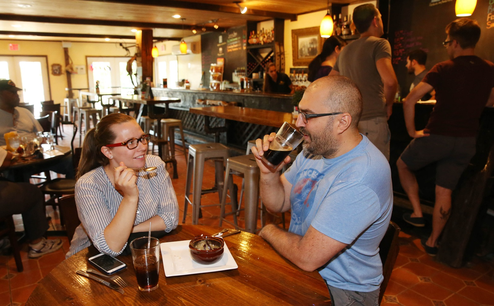 Stephanie and Dan Soda of Buffalo have an appetizer and a drink before their late lunch. (Sharon Cantillon/Buffalo News)