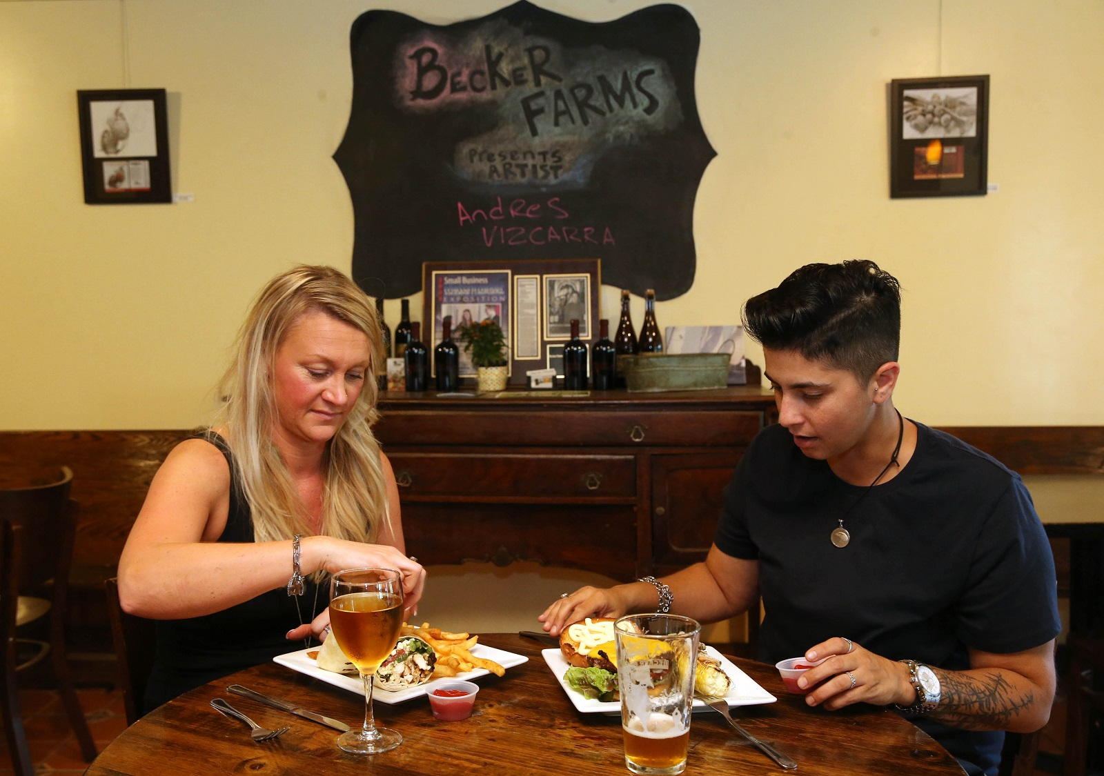 Janie Mroz, left, of Grand Island and Ashley Rossney of Buffalo have a couple of drinks and a bite. (Sharon Cantillon/Buffalo News)
