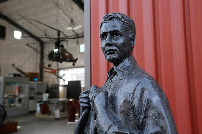 A statue of Navy chaplain Lt. Thomas M. Conway, the last chaplain to die in combat in WWII, in the display yard at the Buffalo and Erie County Naval and Military Park. (Derek Gee/Buffalo News)