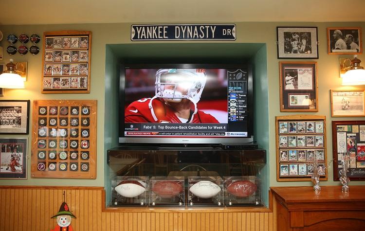 The walls at Marinaro's Larkin Tavern at 131 Van Rensselaer St. in Buffalo are filled with sports memorobilia. Photo taken, Thursday, Sept. 29, 2016. (Sharon Cantillon/Buffalo News)