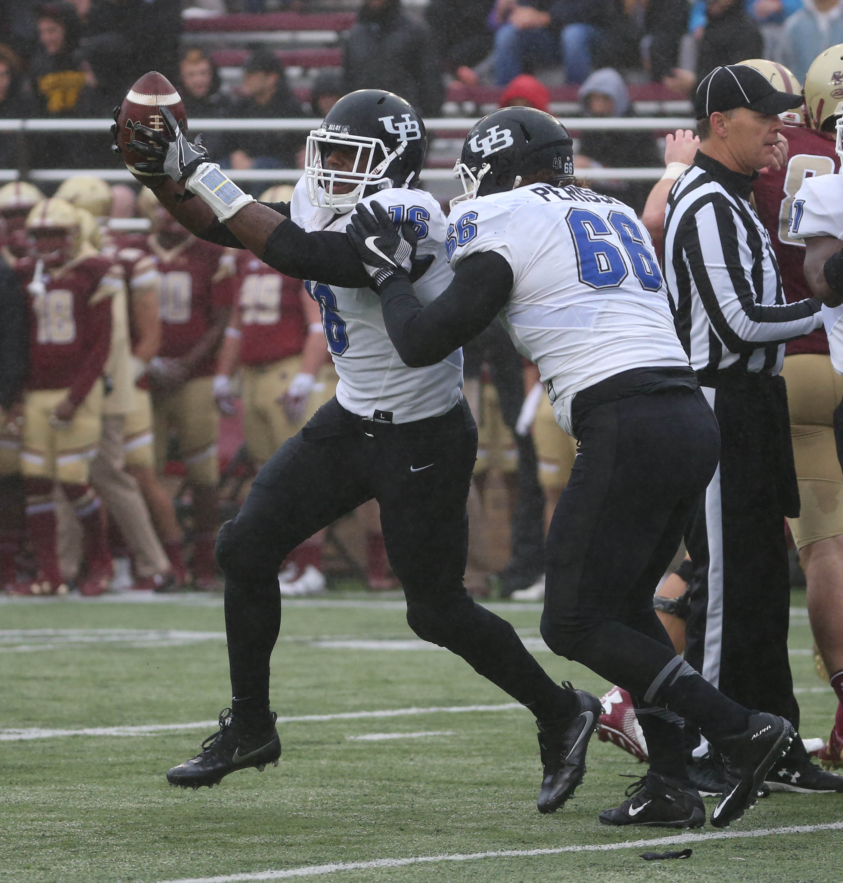 Buffalo Bulls linebacker Ishmael Hargrove (16)  sacks Boston College Eagles quarterback Patrick Towles (8)  and recovers a fumble in the first half at Alumni stadium in Boston, N.Y. on Saturday, Oct. 1, 2016.  (James P. McCoy/ Buffalo News)
