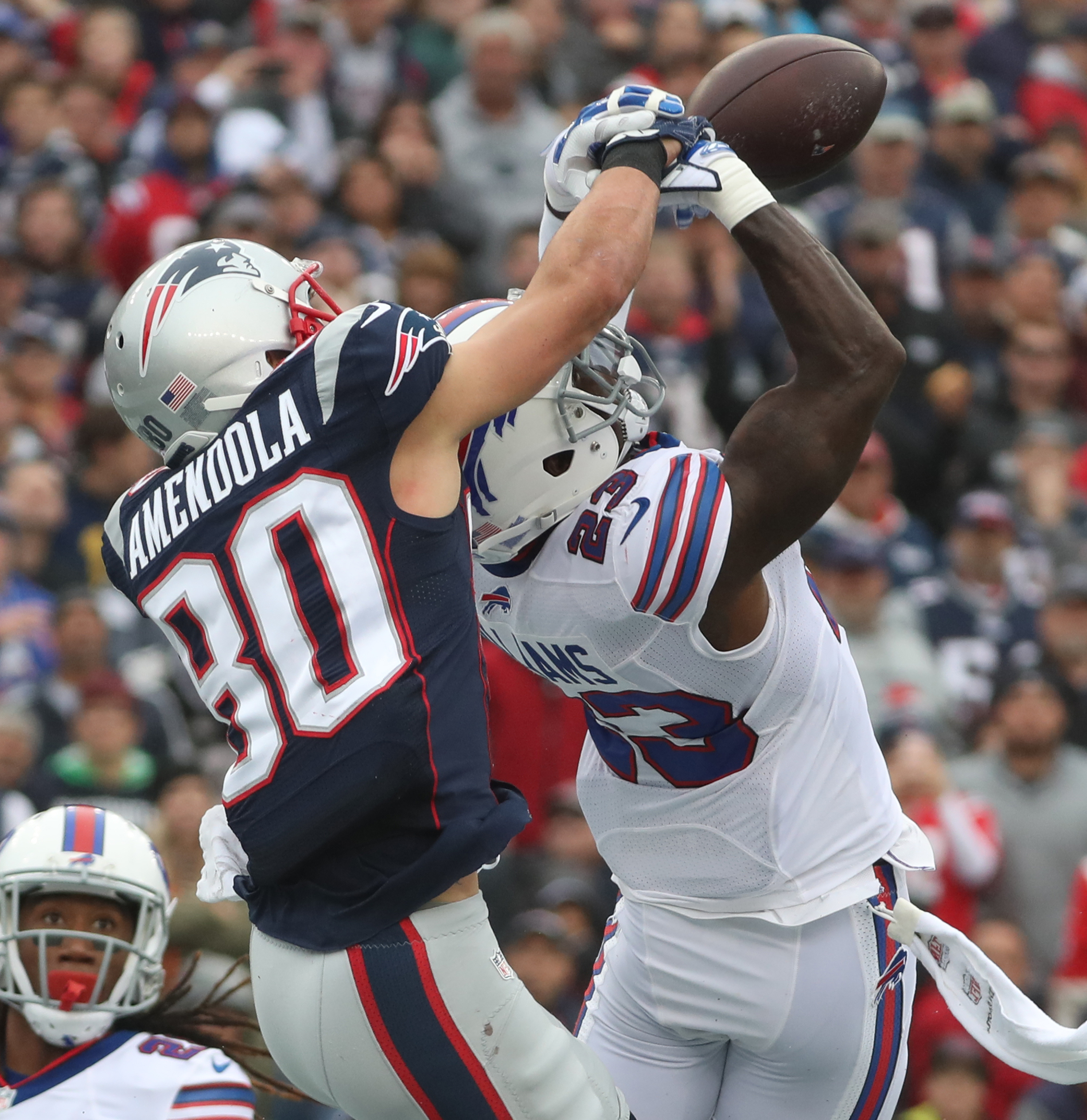 Buffalo Bills strong safety Aaron Williams (23) breaks up a pass intended for New England Patriots wide receiver Danny Amendola (80) in the end zone in the third quarter. (James P. McCoy/ Buffalo News)