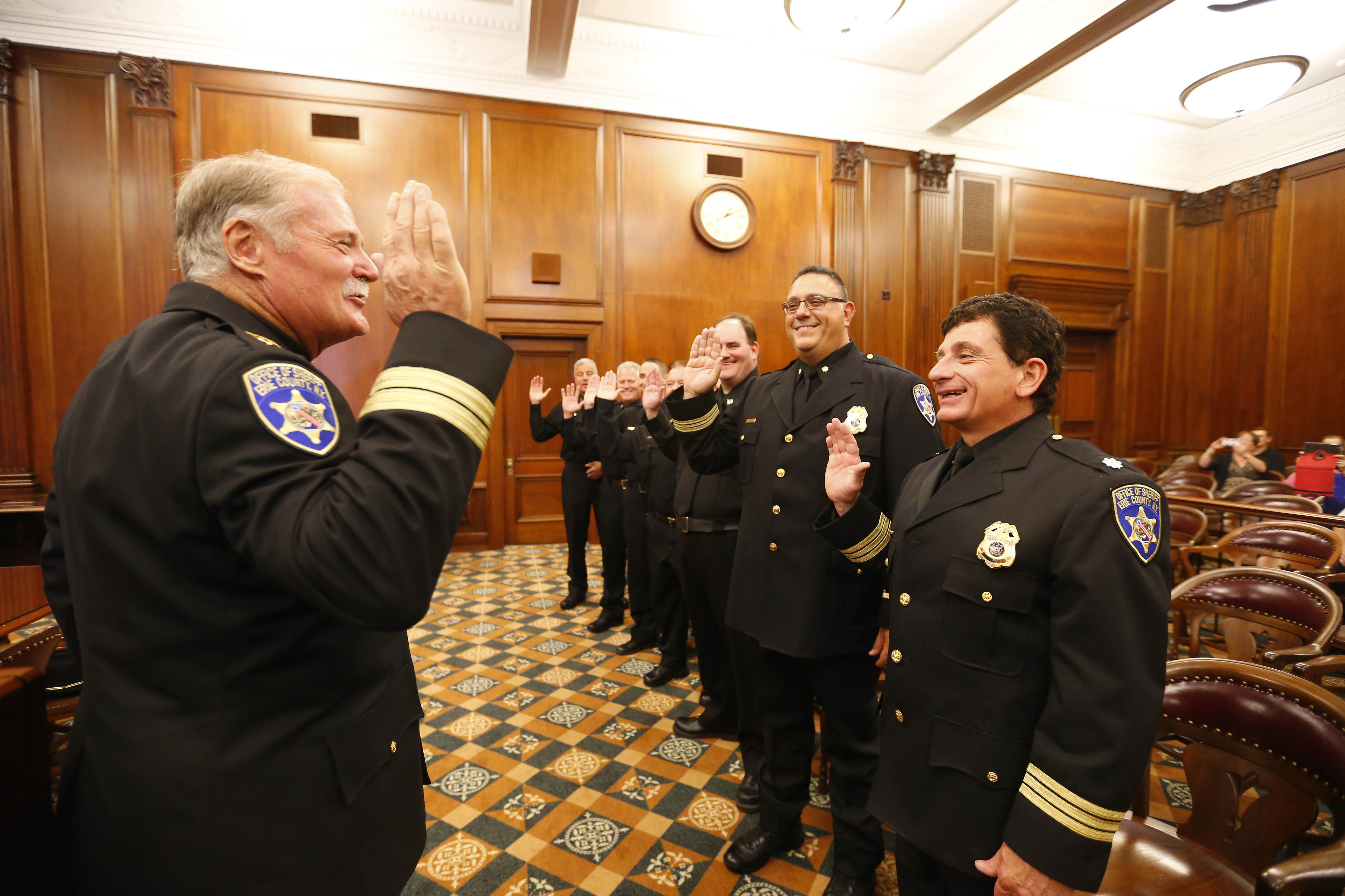 Erie County Sheriff Timothy B. Howard swore in 11 new command staff supervisors for the Jail Management Division in the ceremonial courtroom in Old County Hall on Friday. (Mark Mulville/The Buffalo News)