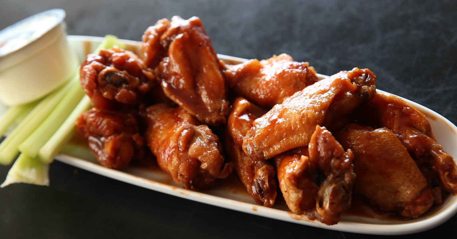 My Tomato Pie's BBQ chicken wings with a side of celery and bleu cheese.(Sharon Cantillon/Buffalo News)