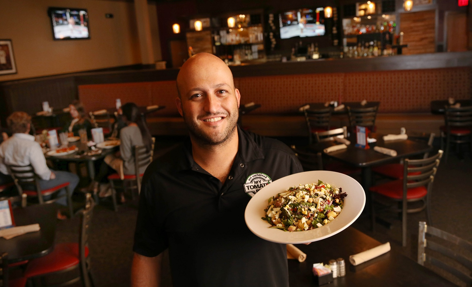 My Tomato Pie owner Anthony Scioli presents the Antoinette's chopped salad. (Sharon Cantillon/Buffalo News)