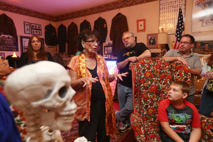 Marge Thielman Hastreiter speaks with guests at the Iron Island Museum where you can take tours late into the night and even stay over night. (Sharon Cantillon/Buffalo News)