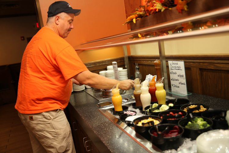 Gary House of Hamburg gets soup from the soup and salad bar at the French Pub in Depew. (Sharon Cantillon/Buffalo News)
