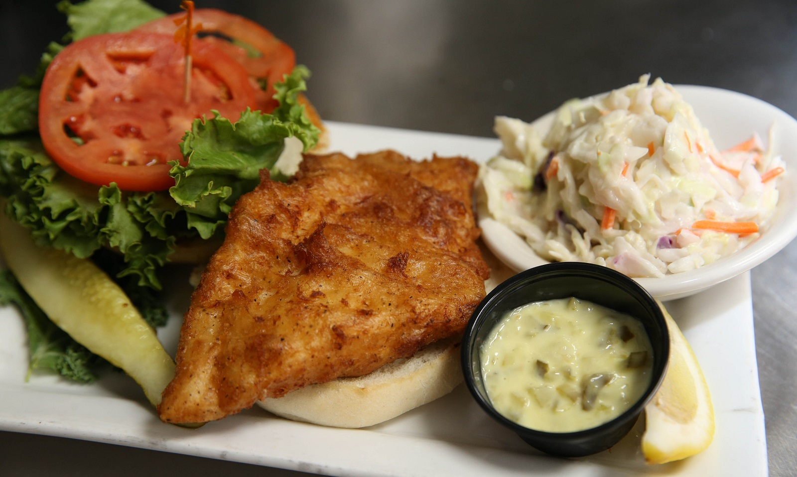 French Pub's fish sandwich with coleslaw and tartar sauce. (Sharon Cantillon/Buffalo News)