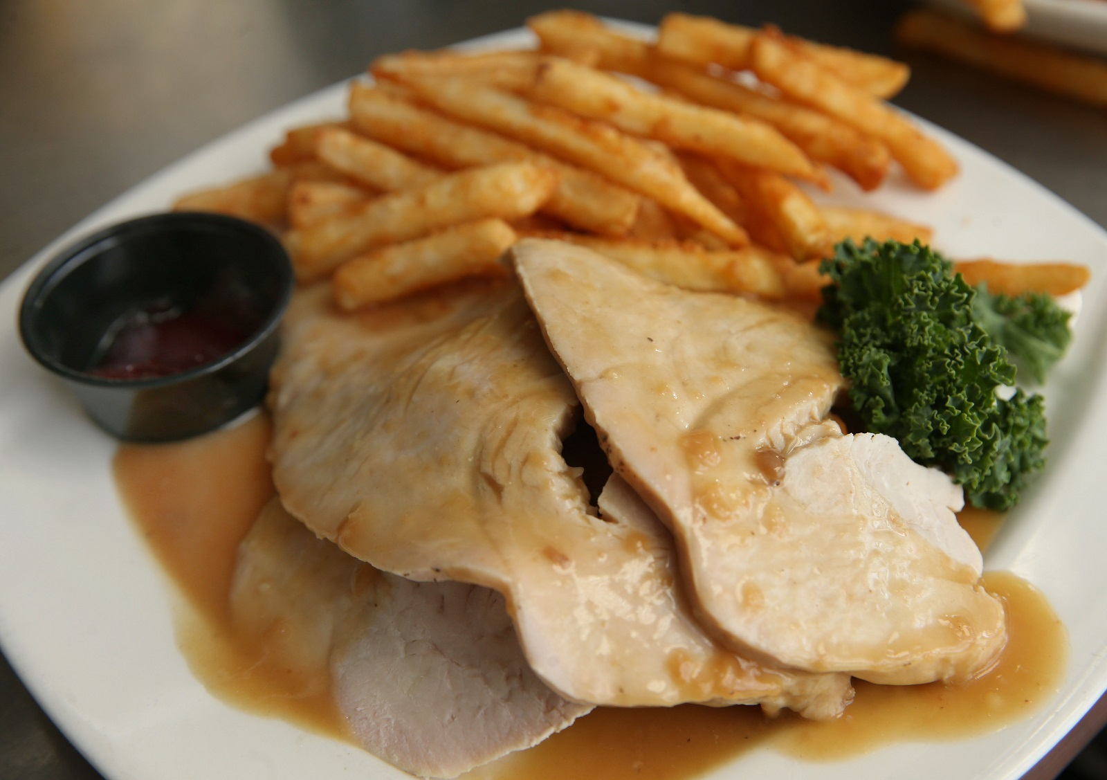 French Pub's Thanksgiving on a plate with turkey over stuffing with gravy. (Sharon Cantillon/Buffalo News)