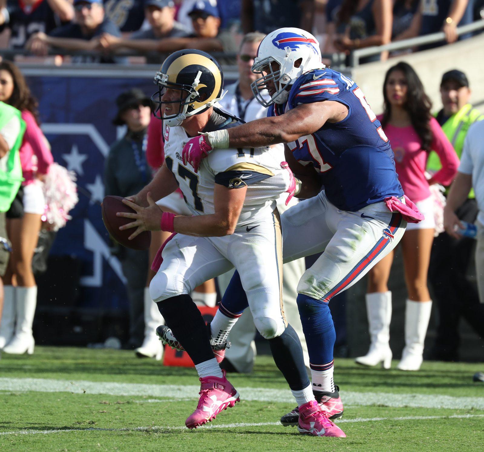 Buffalo Bills outside linebacker Lorenzo Alexander (57) sacks Los Angeles Rams quarterback Case Keenum (17)  and forces an interception at Los Angeles Memorial Colliseum. (James P. McCoy/ Buffalo News)