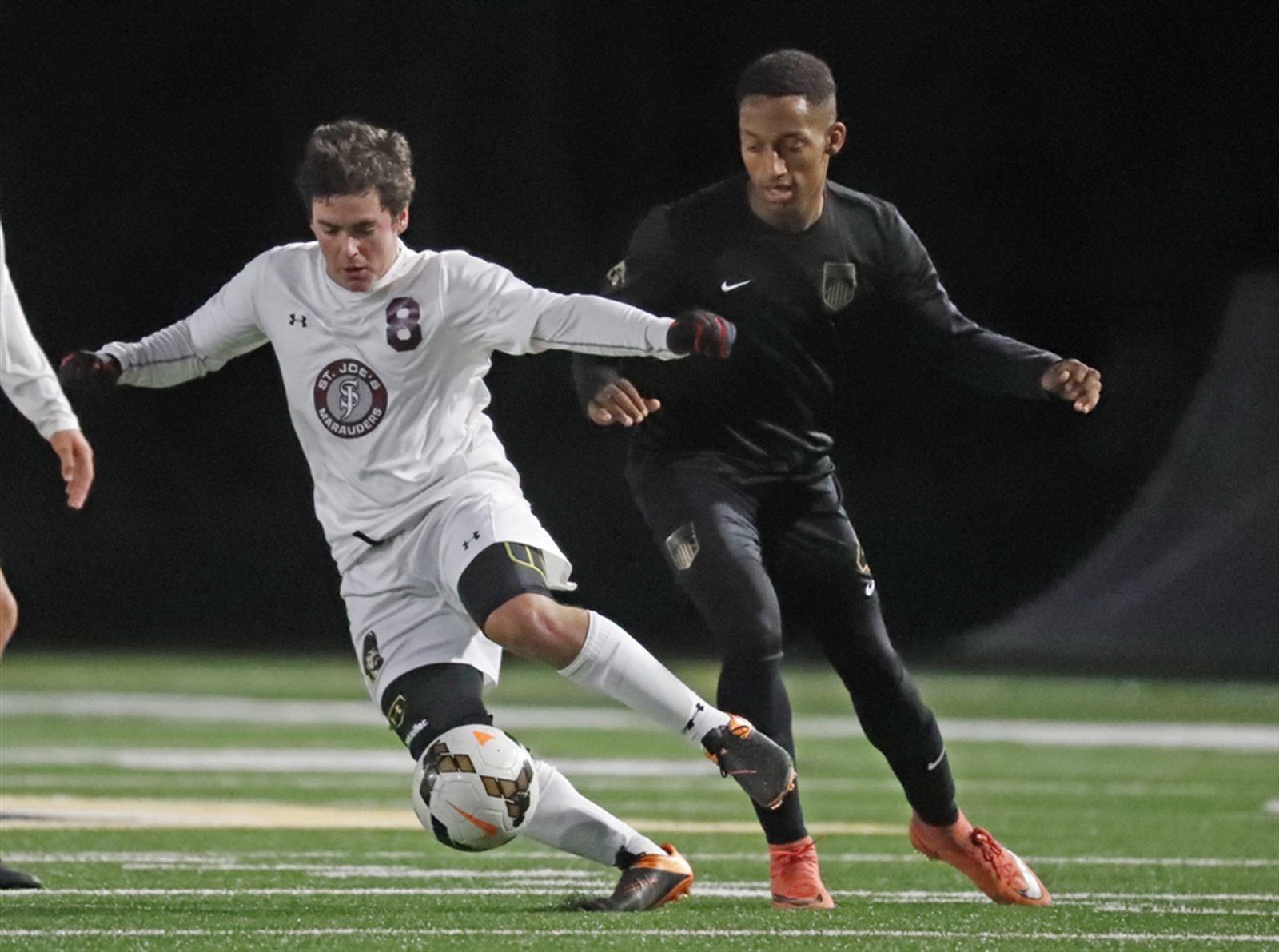 Spencer Frome (8) and St. Joe's host Lackawanna in a nonleague boys soccer match Tuesday. (Harry Scull Jr./Buffalo News)