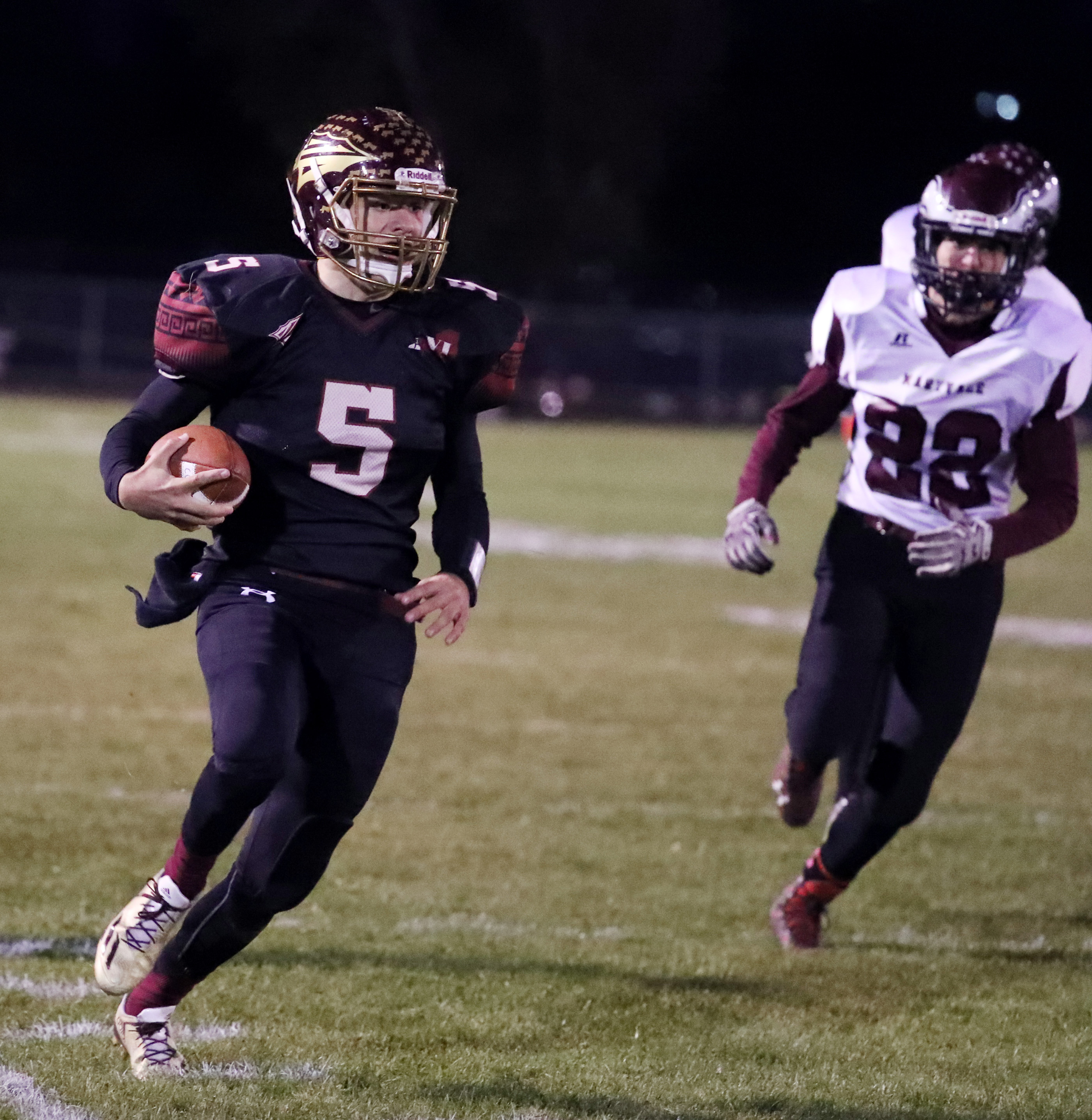 Cheektowaga's Eric Bartnik capped a five-touchdown performance by scoring the game-deciding one during the Warriors' overtime triumph over rival Maryvale on Friday.  (James P. McCoy/ Buffalo News)