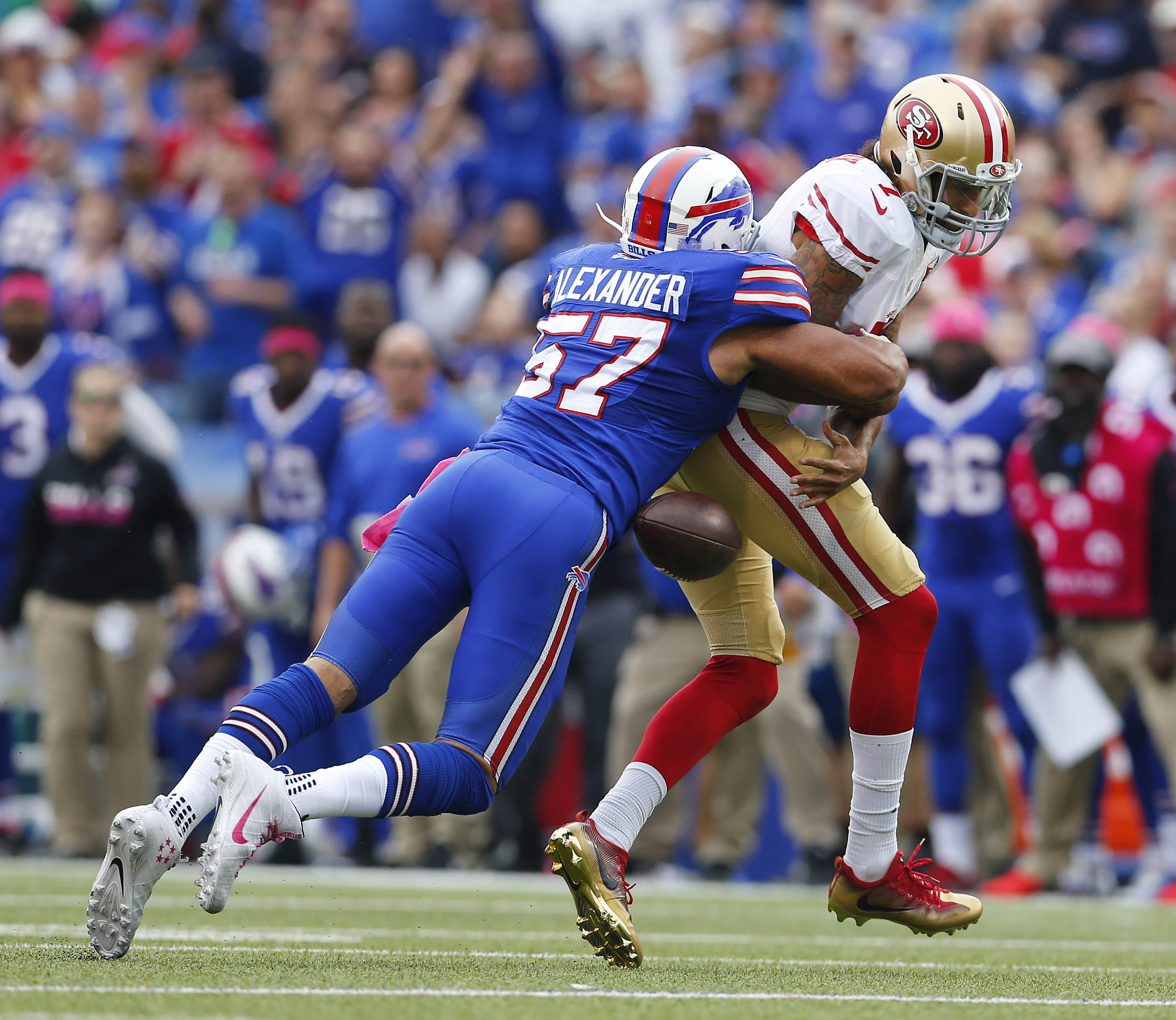 Lorenzo Alexander forces a fumble by San Francisco 49ers quarterback Colin Kaepernick in the fourth quarter. (Mark Mulville/The Buffalo News)