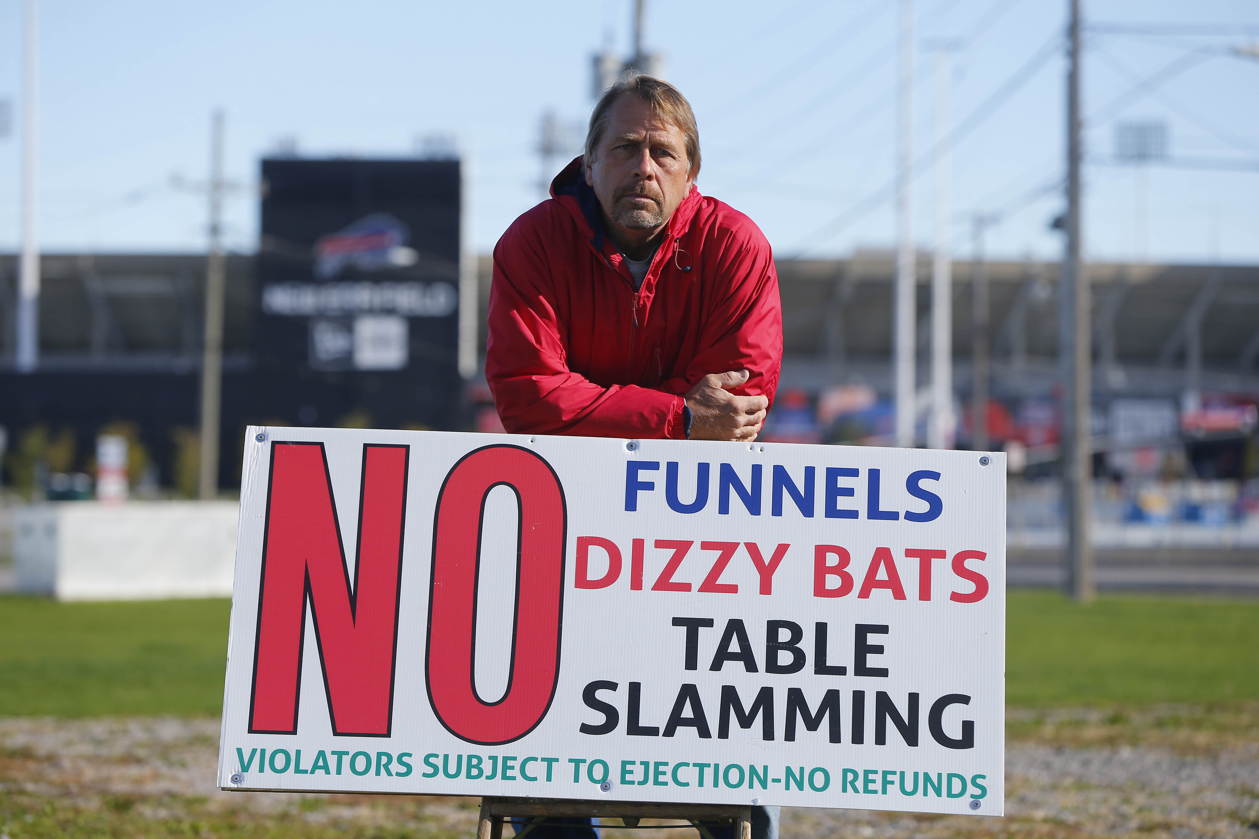 Hammer's Lot owner Eric Matwijow leaves little doubt about rules for his game-day customers outside Bills games.  (Mark Mulville/Buffalo News)