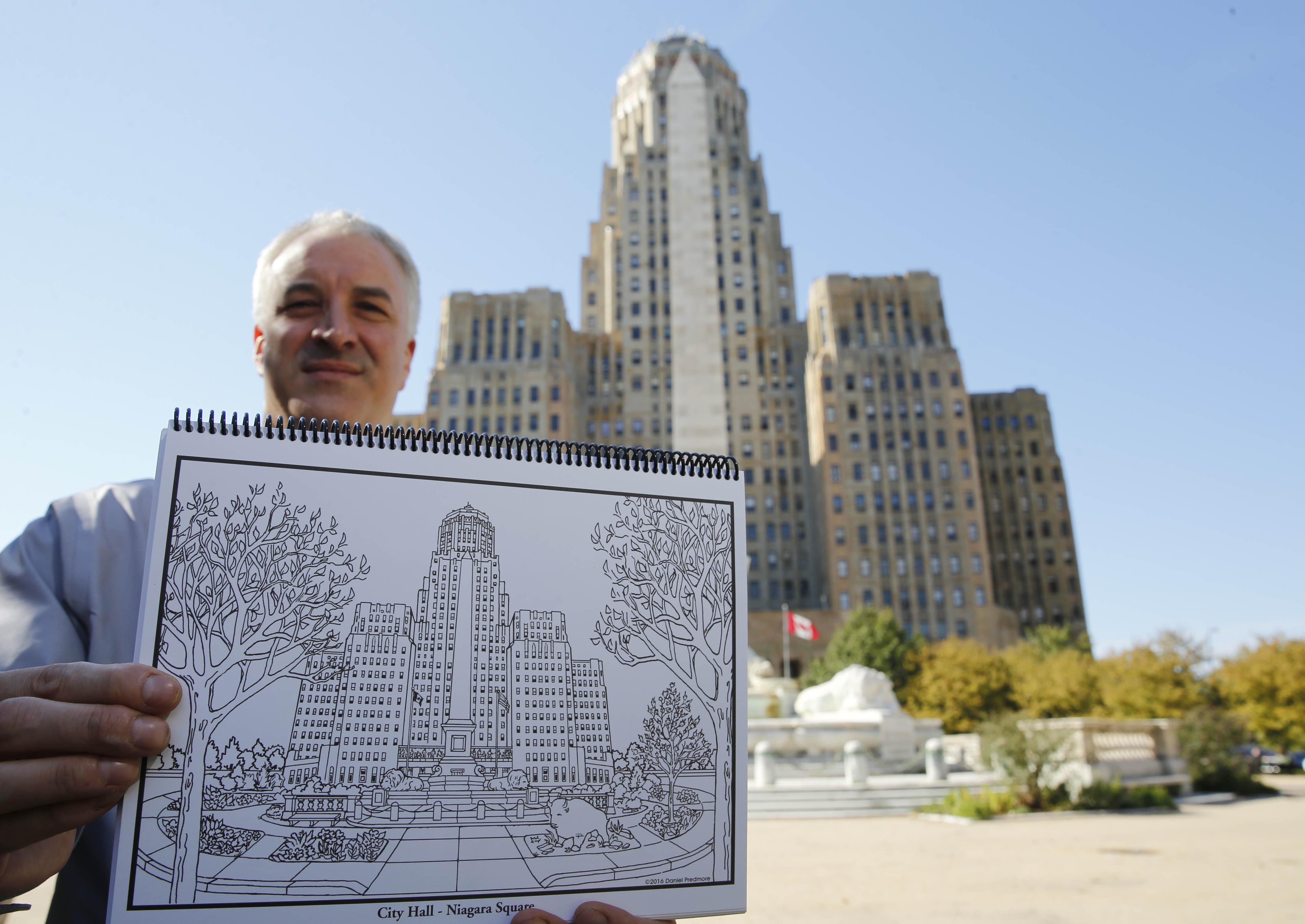 Daniel Predmore has a new coloring book featuring downtown Buffalo, Wednesday, Oct. 12, 2016.  (Derek Gee/Buffalo News)