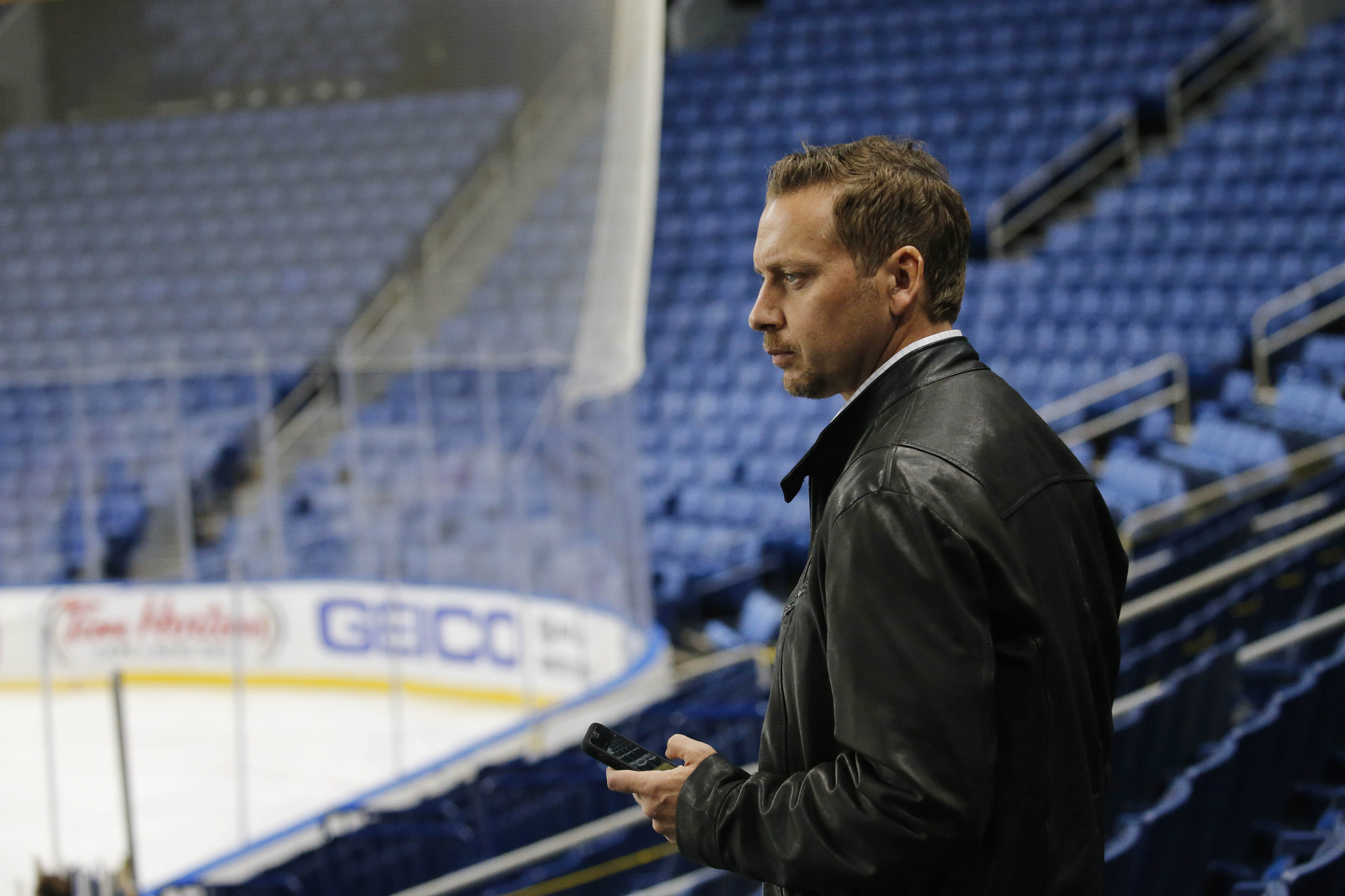 Sportscaster Adam Benigni of WGRZ is back to work covering the Buffalo Sabres at KeyBank Center. (Derek Gee/Buffalo News)
