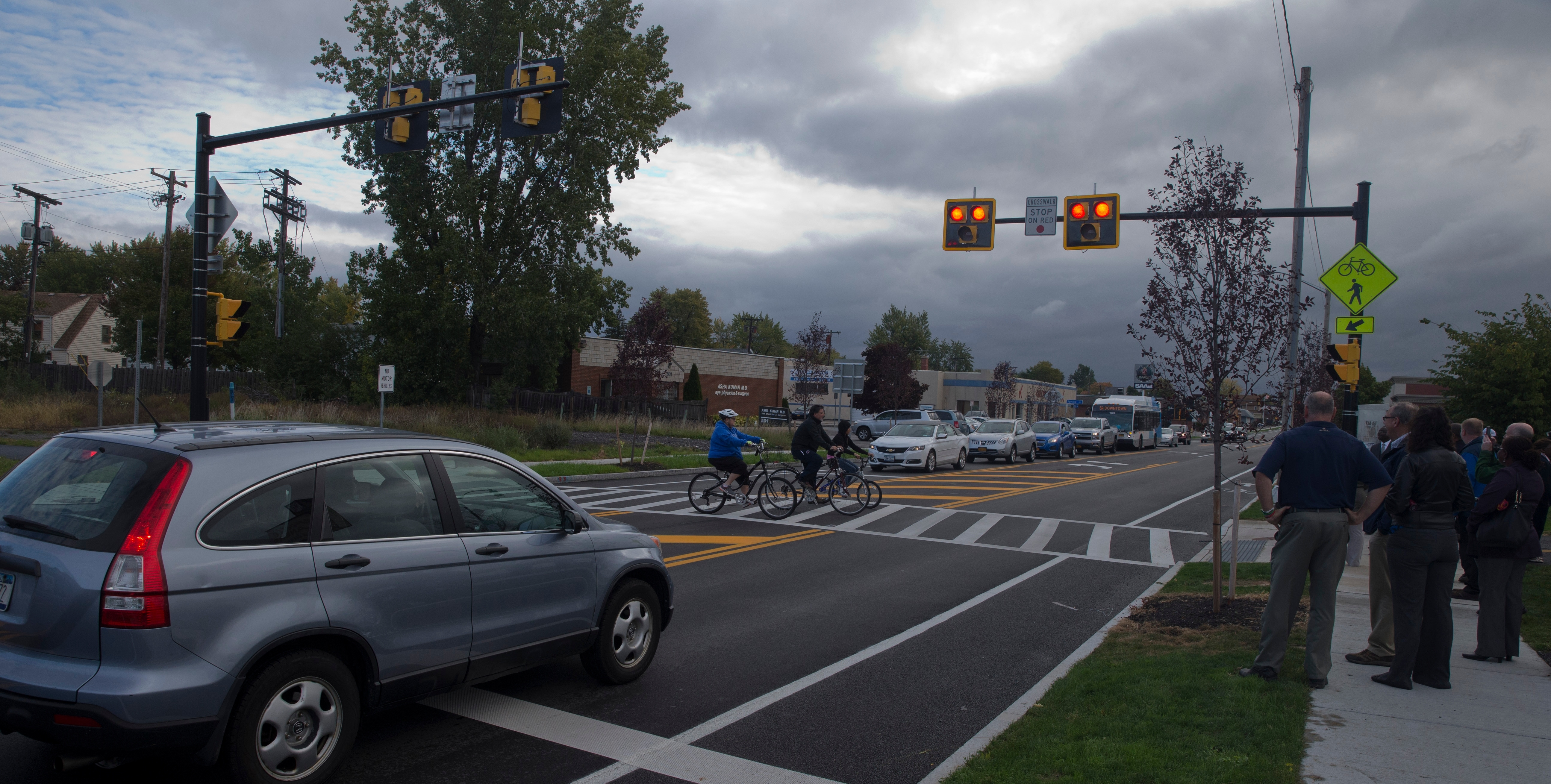 Buffalo City and Town of Tonawanda and County officials look on as bicyclist use newest  HAWK (High intensity Activated crossWalK) crosswalk located  at  Kenmore Avenue, at intersection of North Buffalo Rails to Trails crossing, in Buffalo, N.Y. on Thursday Oct. 13, 2016.  (John Hickey/Buffalo News)
