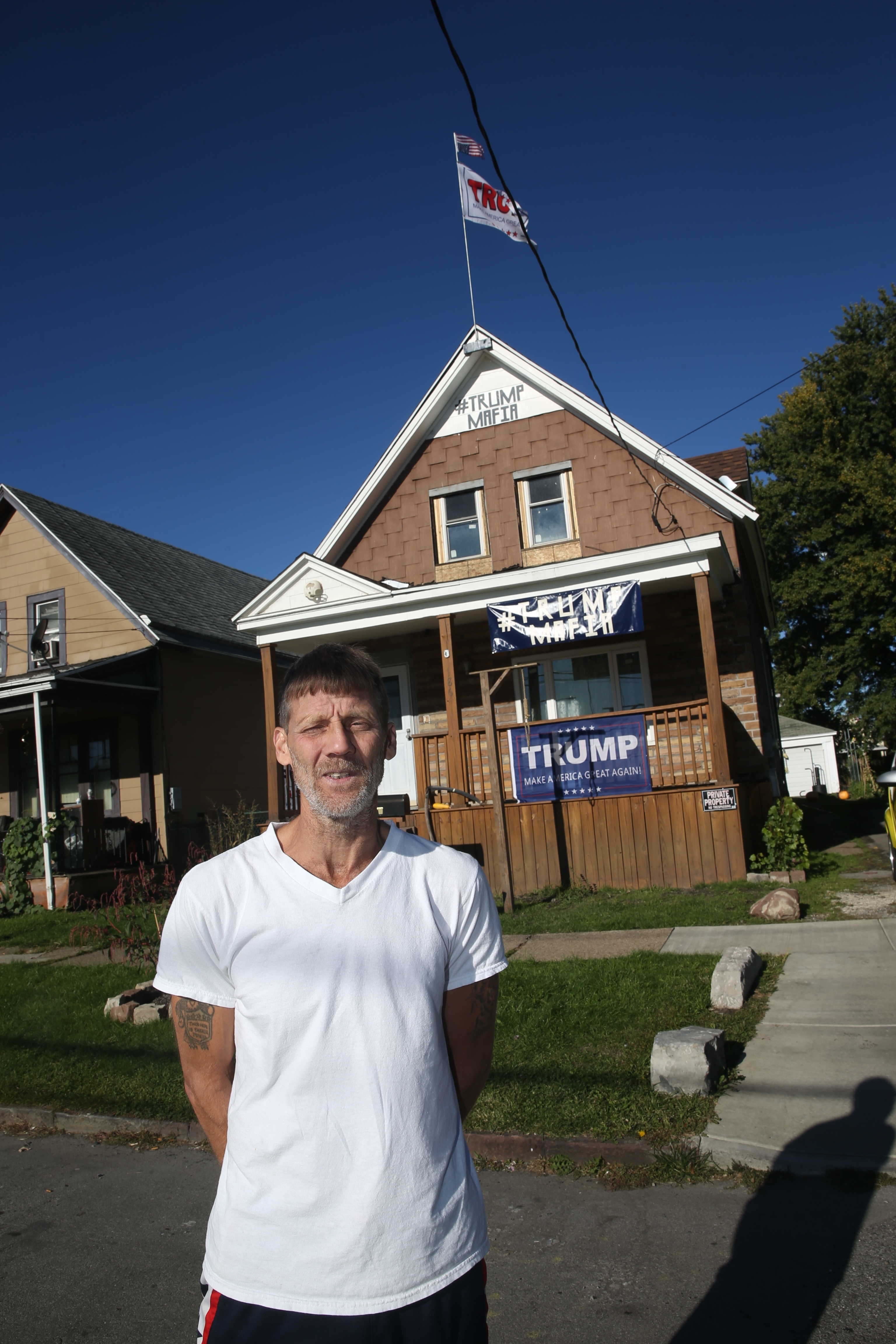 Egbert Bickley in front of his Babcock Street home. (John Hickey/Buffalo News)