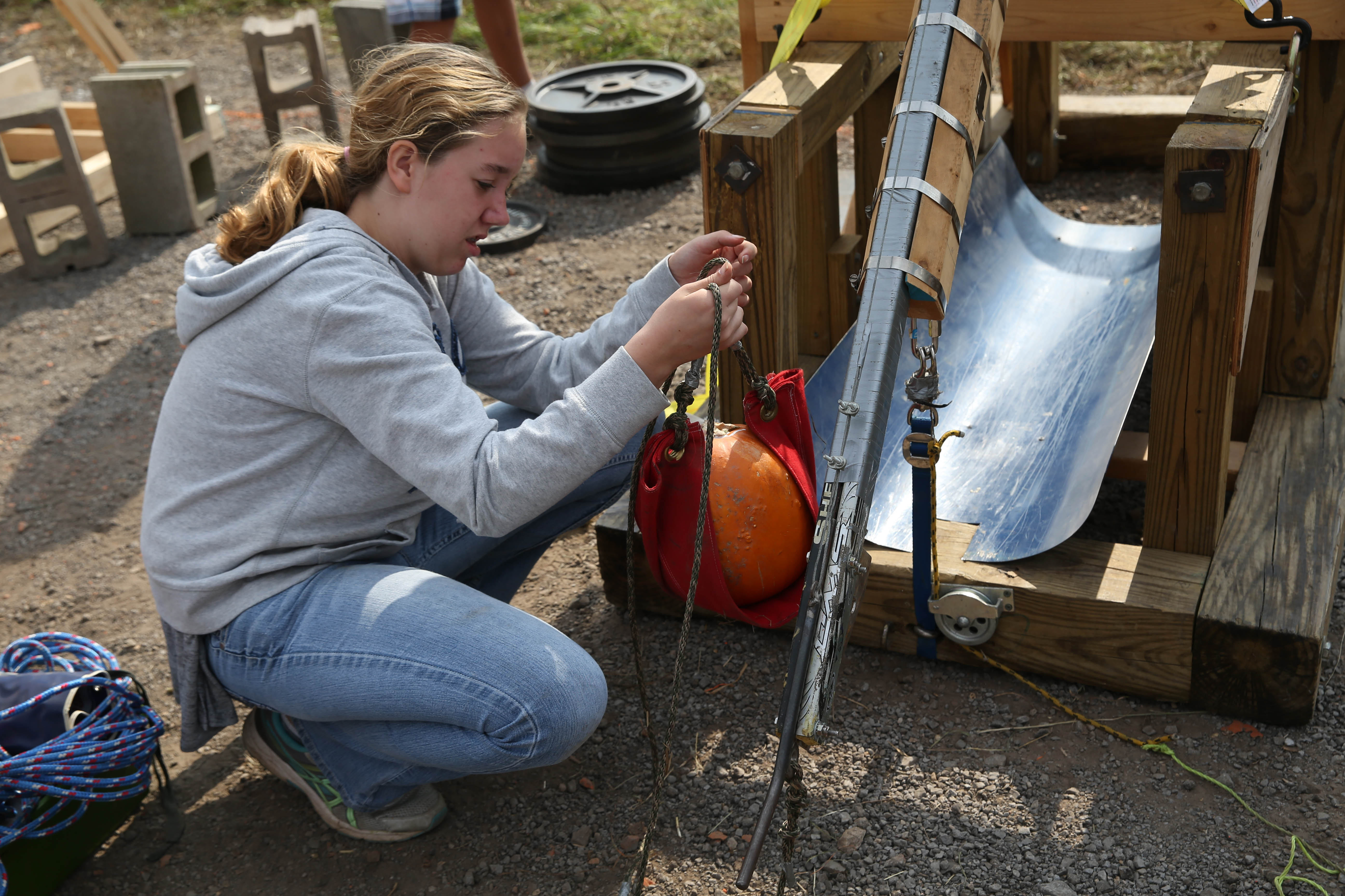 Angelica Tobe of Hamburg High School puts the pumpkin into the sling. (Sharon Cantillon/Buffalo News)