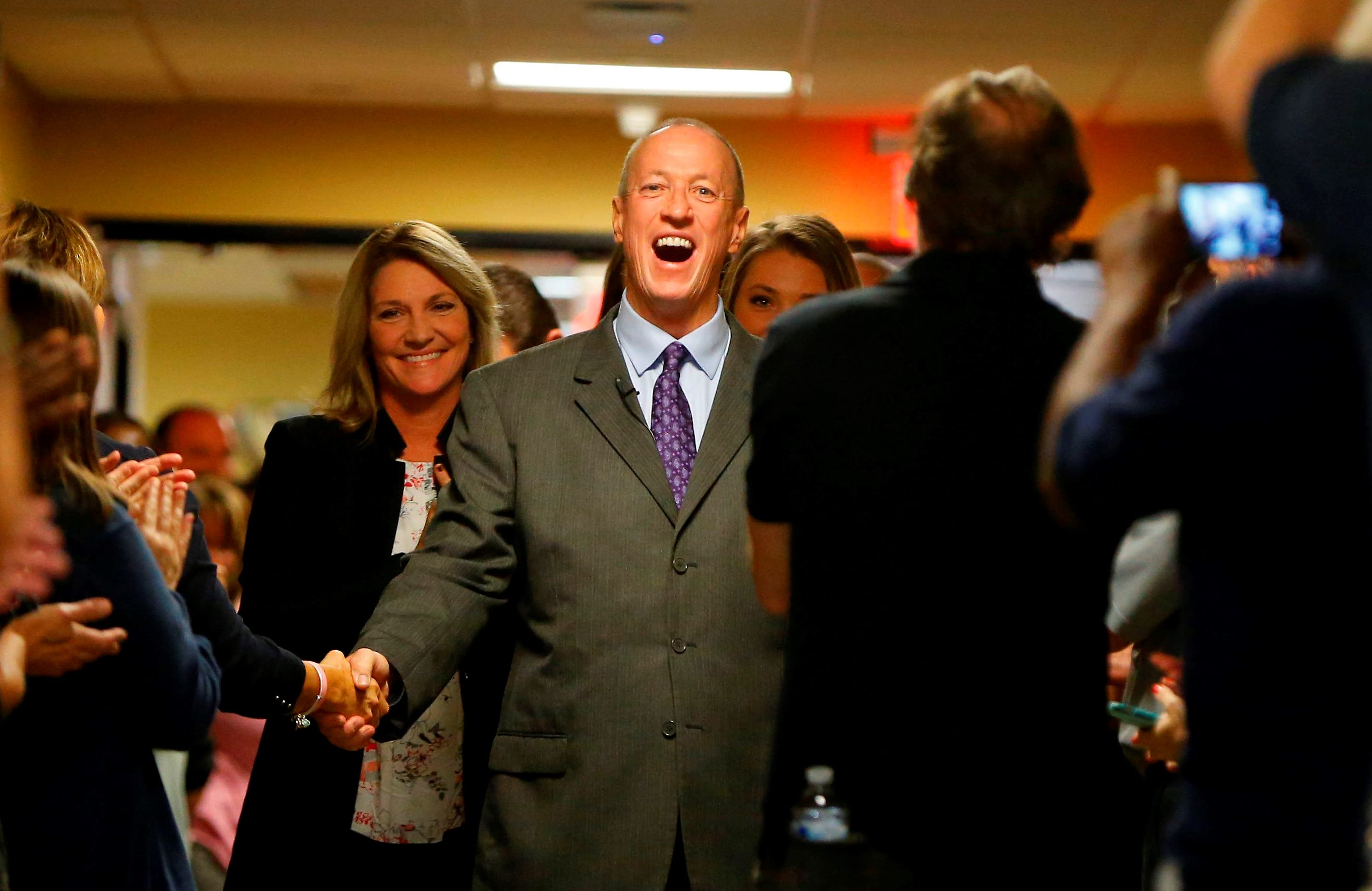 "Jim Kelly is greeted by ECMC administrators and staff before his ""Kelly Tough"" room dedication on the 10th floor of the hospital on Tuesday, Oct. 18, 2016.  It is the same room where he stayed when he received his treatment in 2013 and 2014. (Mark Mulville/The Buffalo News)"