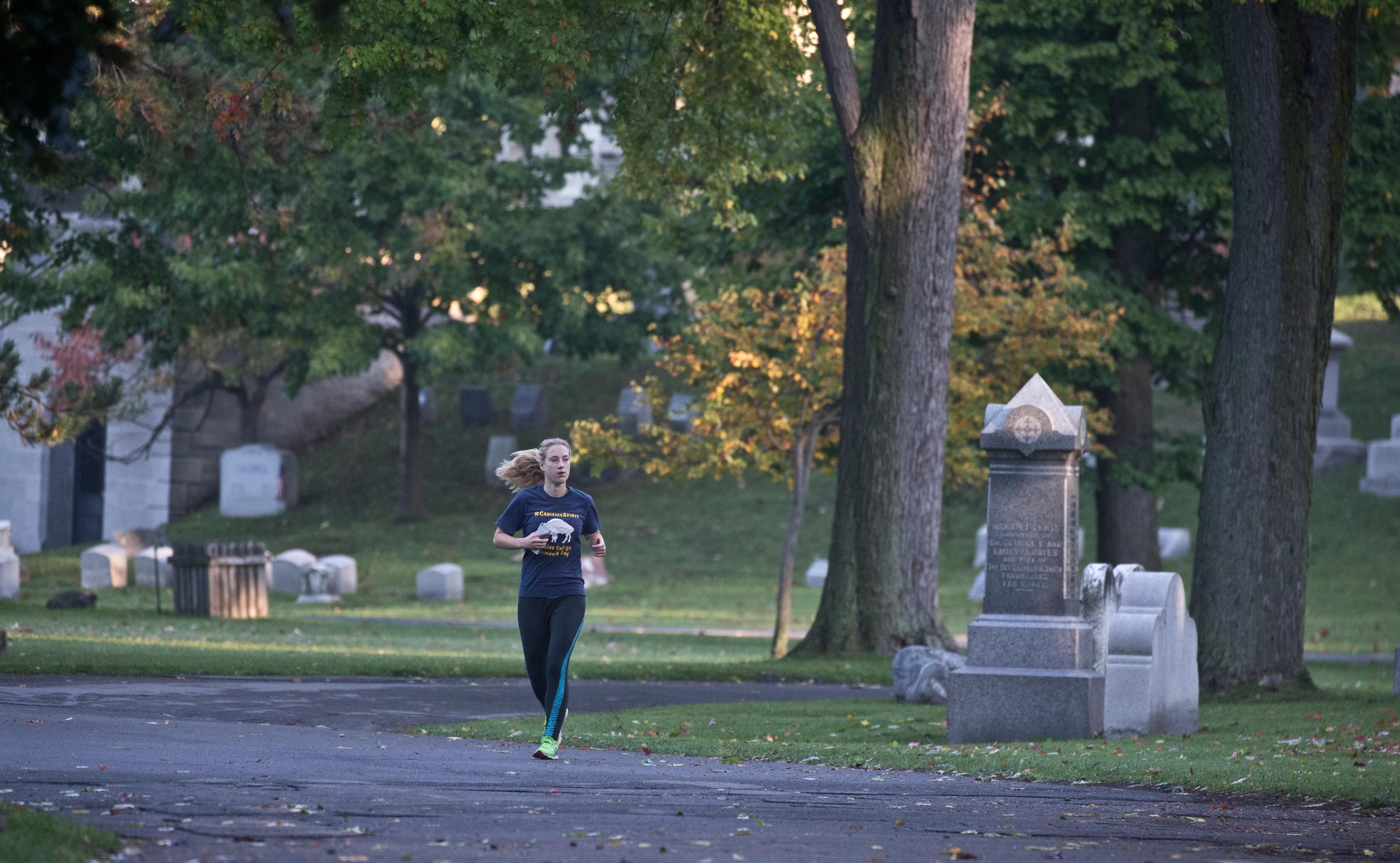 Rebekah Gordon from Horseheads, N.Y., runs through Forest Lawn Cemetery. (John Hickey/Buffalo News)