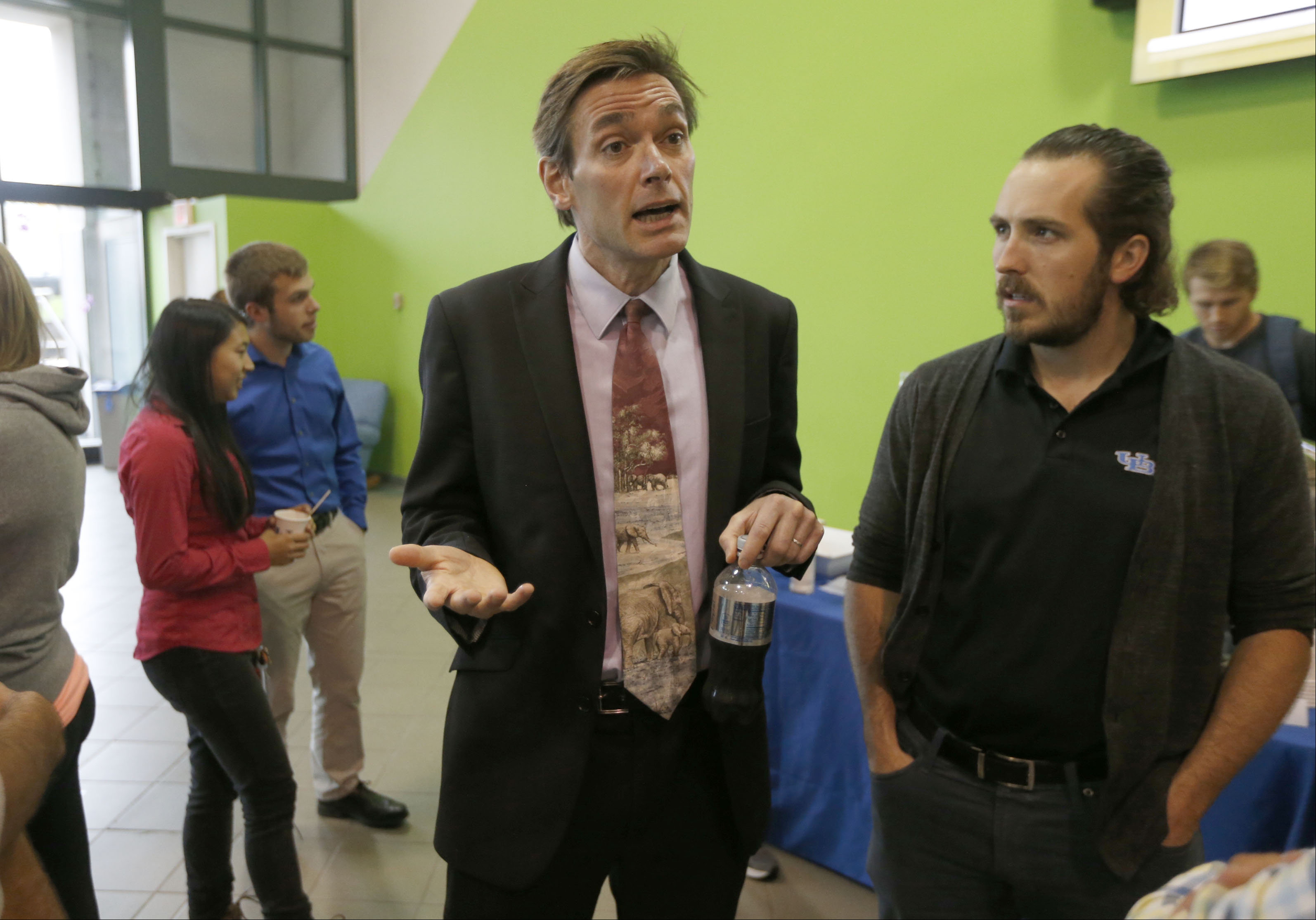Marc Edwards, left, speaking with students before his mini-lecture in the Student Union on UB's North Campus on Thursday, Oct. 20, 2016. (Robert Kirkham/Buffalo News)