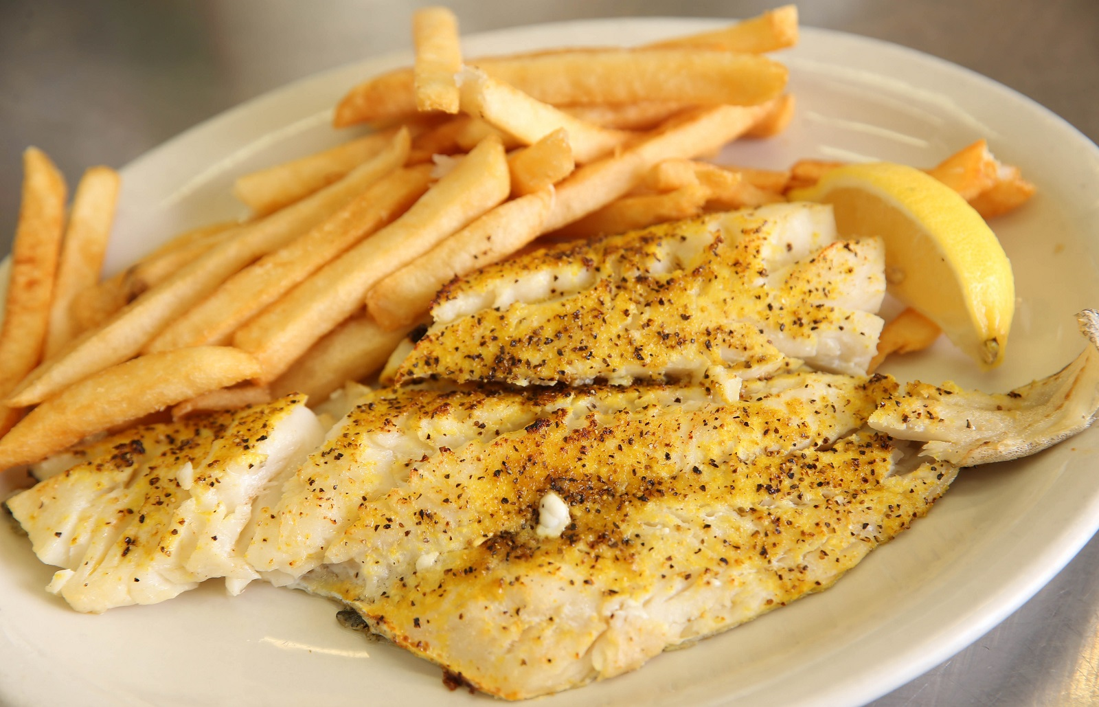 This is the lemon pepper broiled fish dinner. Potato and macaroni salads are available at the salad bar. (Sharon Cantillon/Buffalo News)