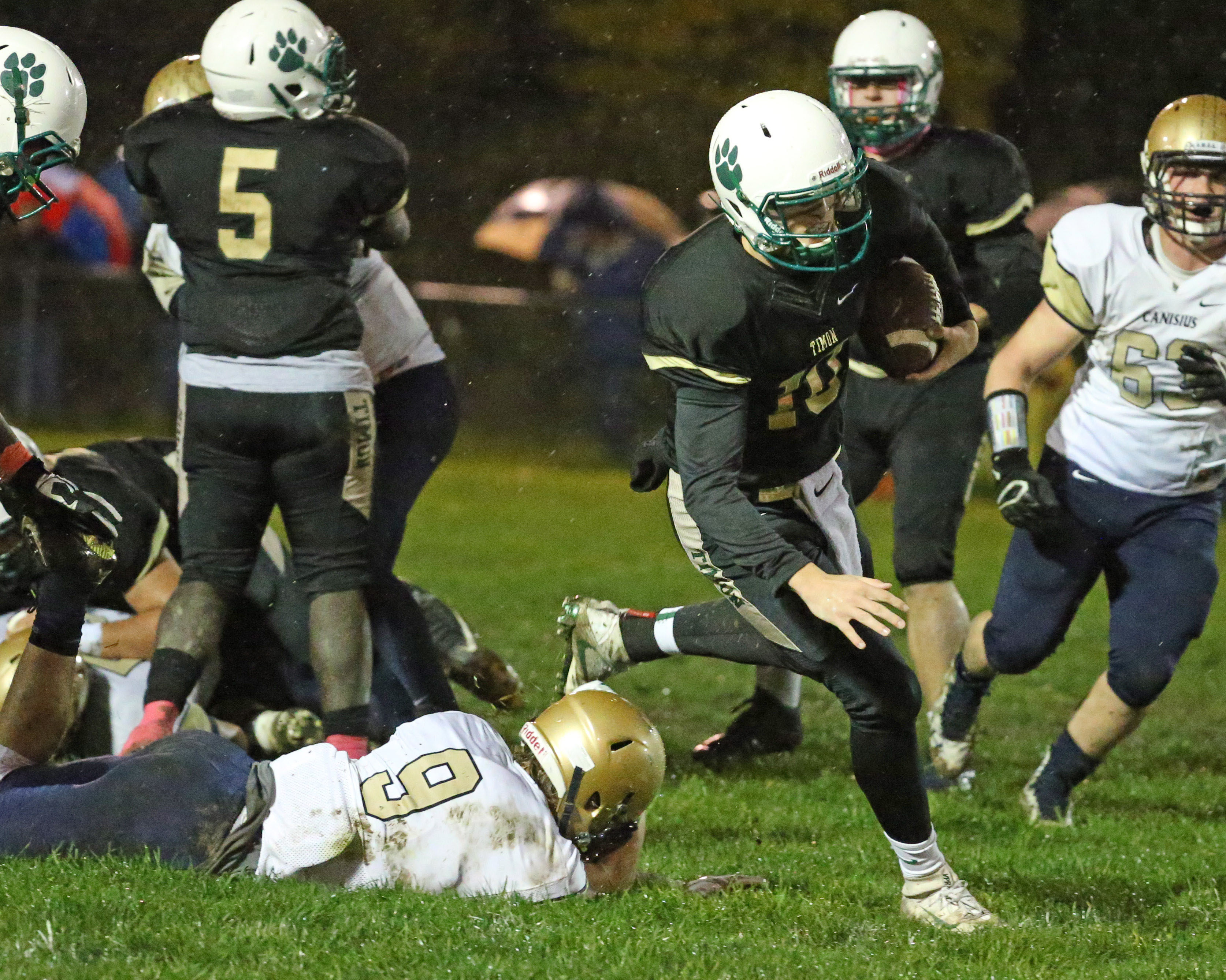 Timon's Matt Myers beats Canisius' Jacob Lutz for a first down in the first quarter Friday night. (James P. McCoy/Buffalo News)