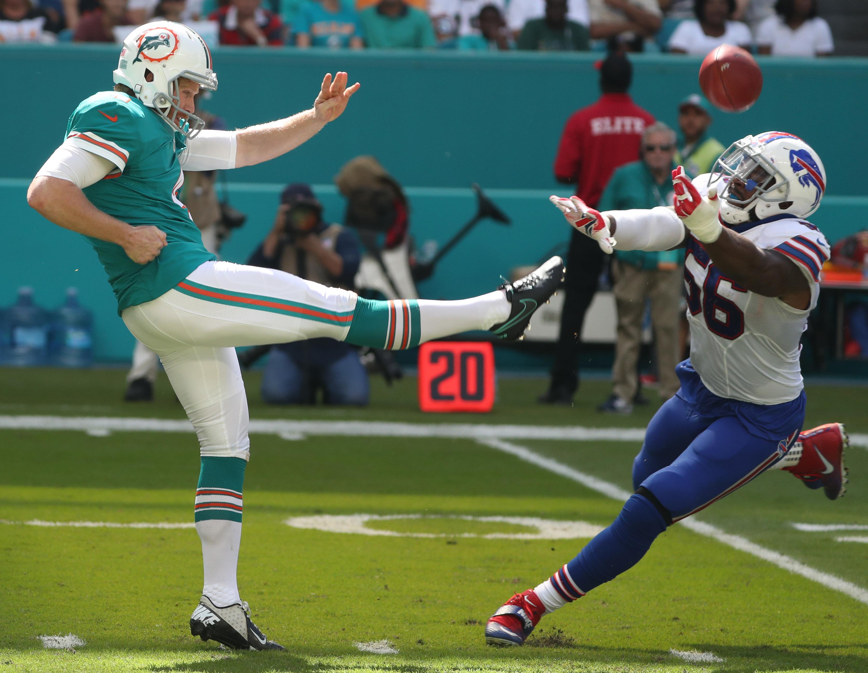 Buffalo Bills linebacker Lerentee McCray blocks the punt of Miami Dolphins punter Matt Darr in the second quarter. (James P. McCoy/Buffalo News)