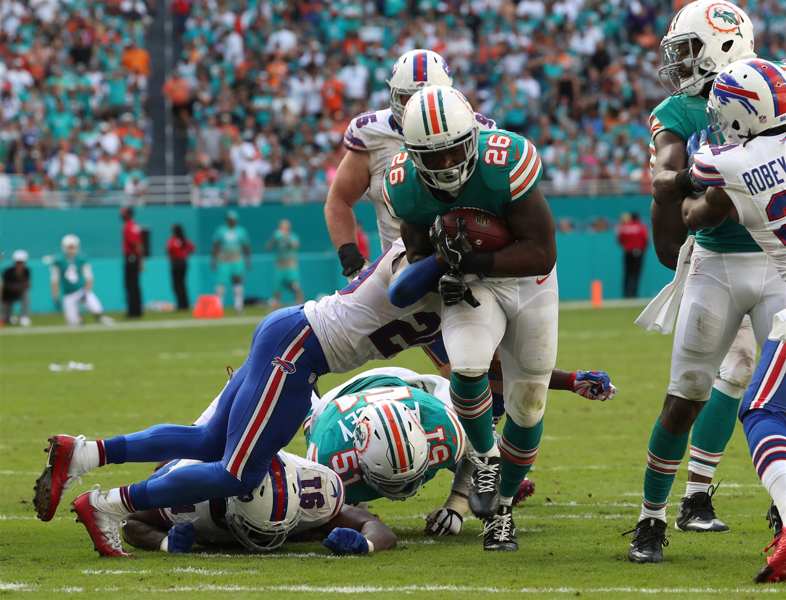 Bills safety Corey Graham can't bring down Dolphins running back Damien Williams on Sunday. Missed tackles were a big problem for the Buffalo defense. (James P. McCoy/Buffalo News)