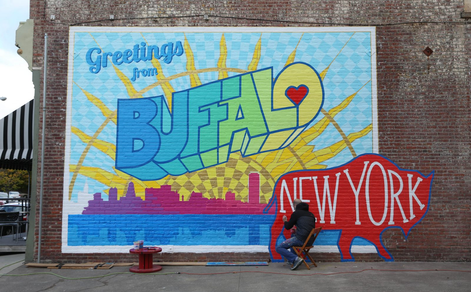 New Greetings from Buffalo mural appears on Ellicott Street The