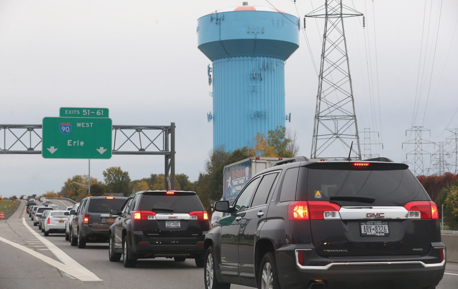 The Town of Amherst blue water tower looms large during rush hour traffic in this 2016 photo. The Amherst landmark didn't factor in the best of the also-ran official slogan entries. (Sharon Cantillon/News file photo)