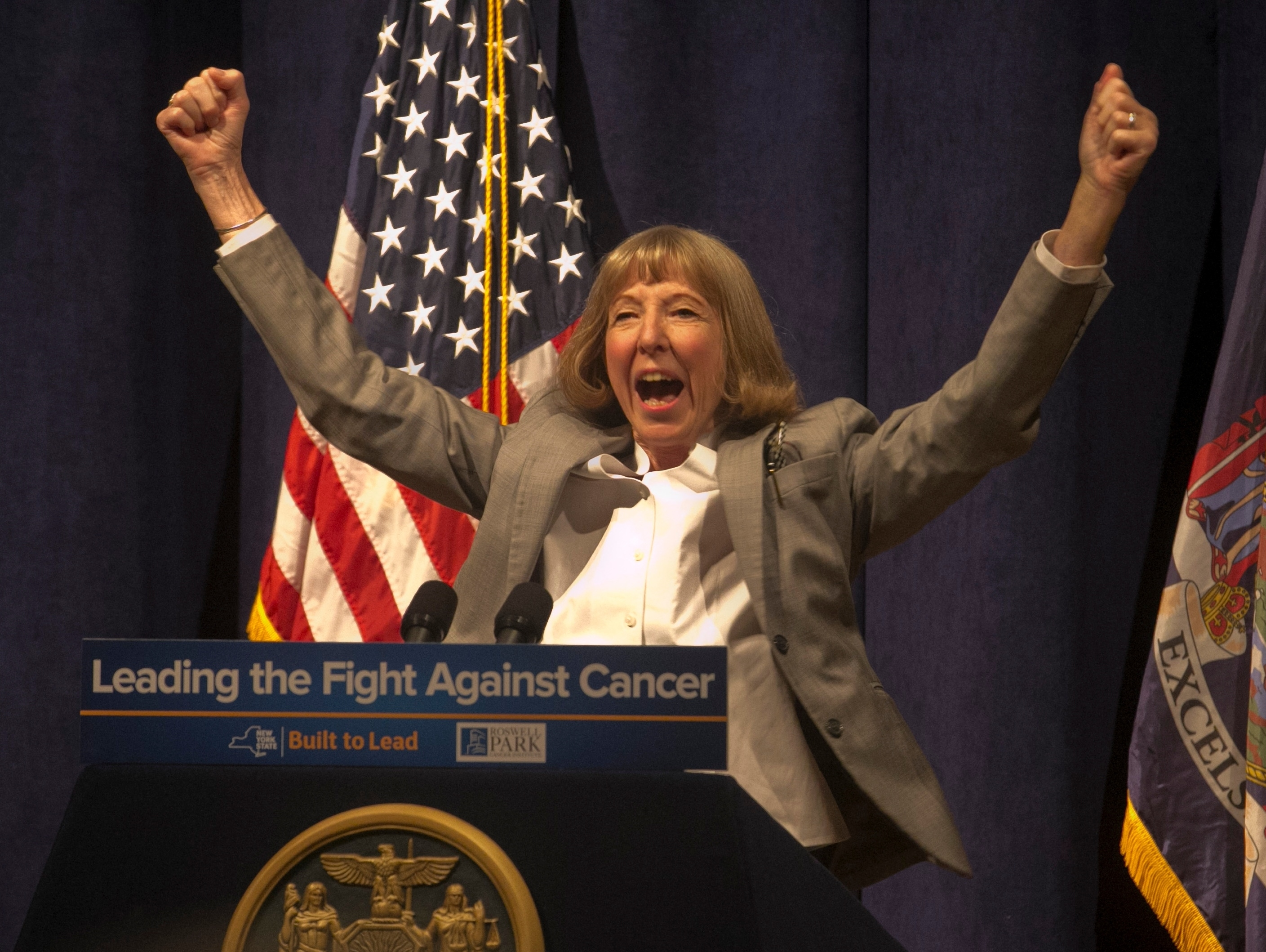 A jubilant Dr. Candace Johnson, president and CEO of Roswell Park Cancer Institute, announces FDA approval of clinical trial of a lung cancer vaccine from Cuba. (John Hickey/Buffalo News)