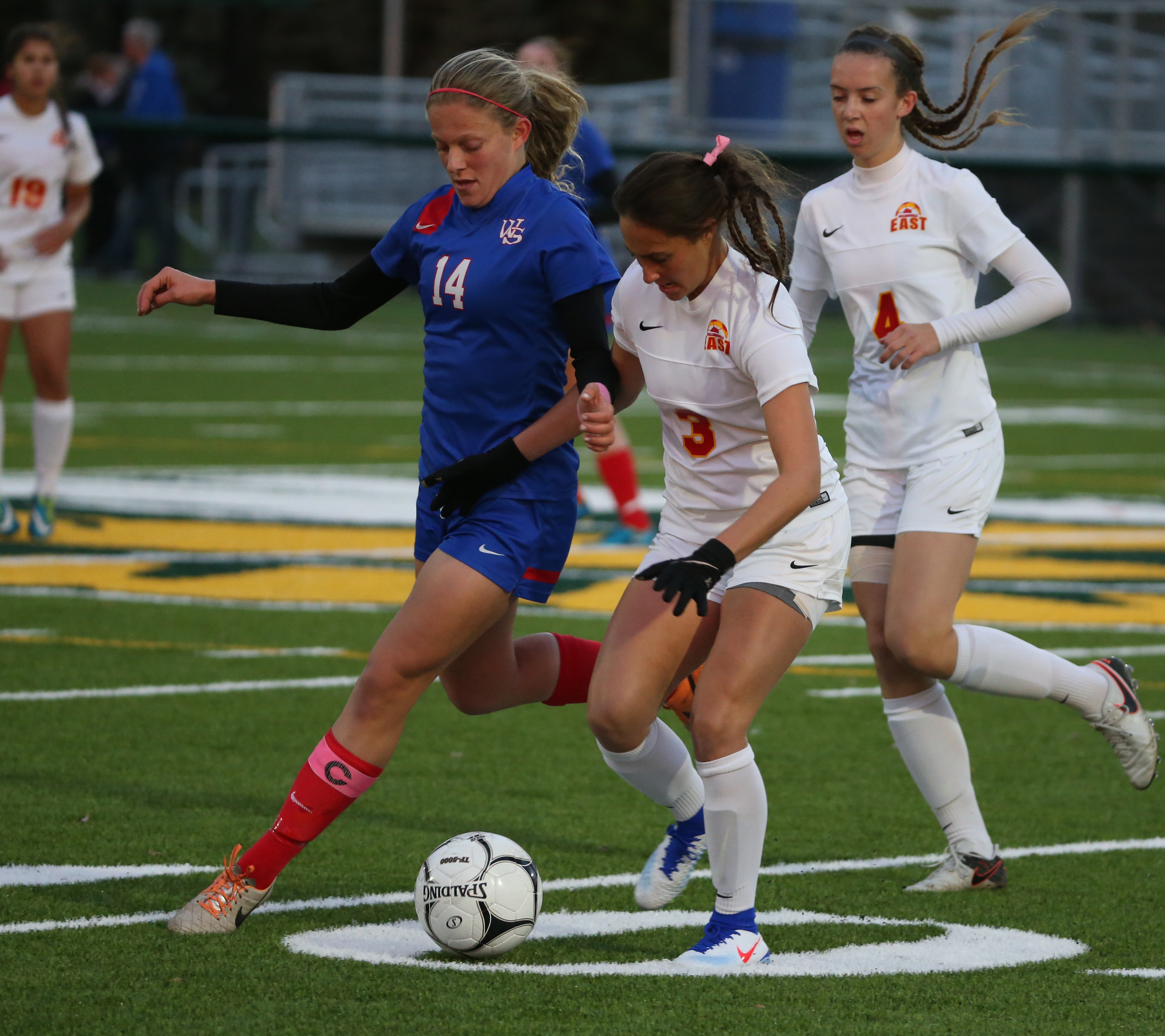 Williamsville East's Marissa Cirulli battles Williamsville South's Nicole Gruber for the ball in the first half of their sectional game Tuesday (James P. McCoy/Buffalo News).
