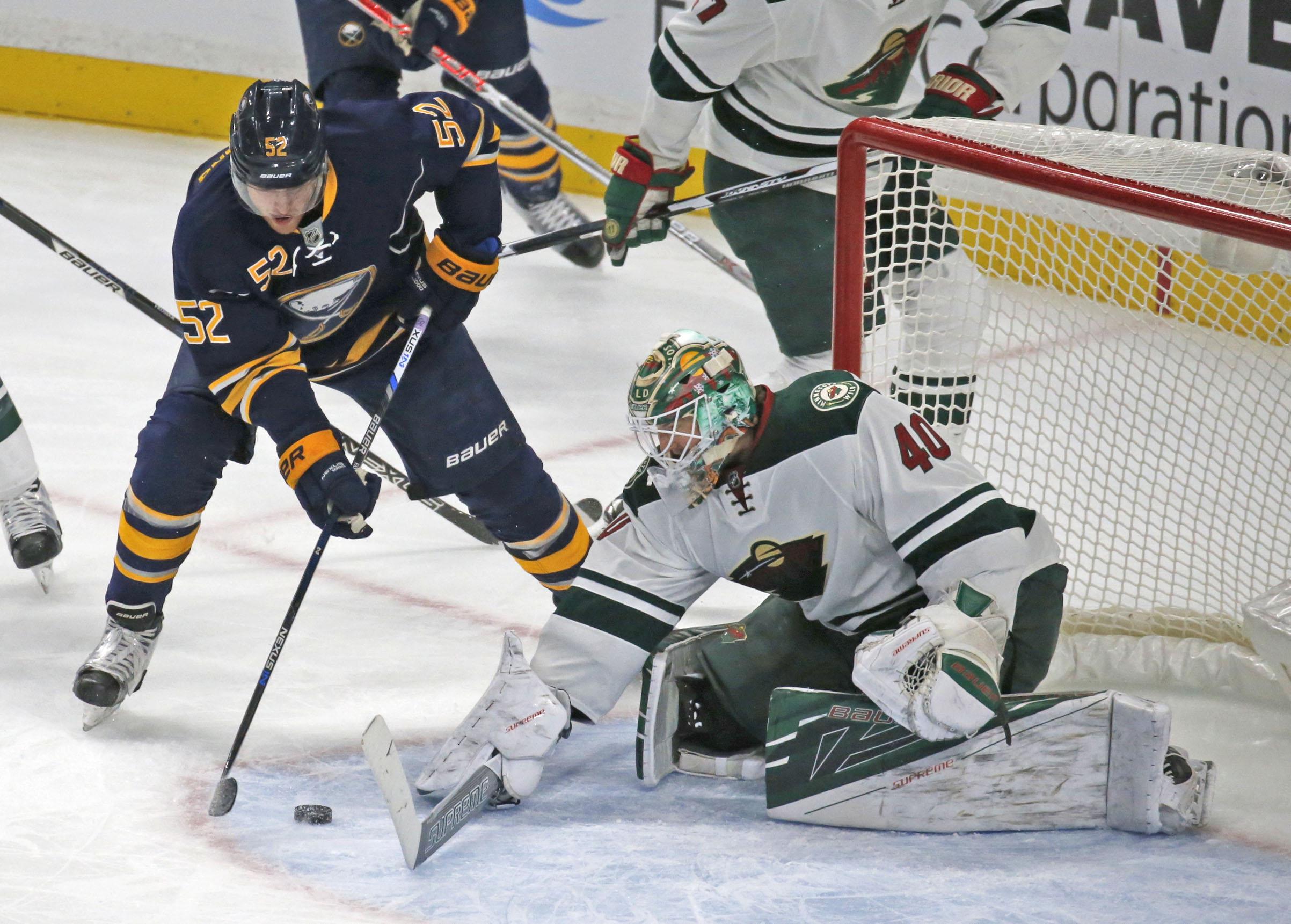 Buffalo's Hudson Fasching (52) is stopped in tight by Minnesota goalie Devan Dubnyk (Robert Kirkham/Buffalo News).