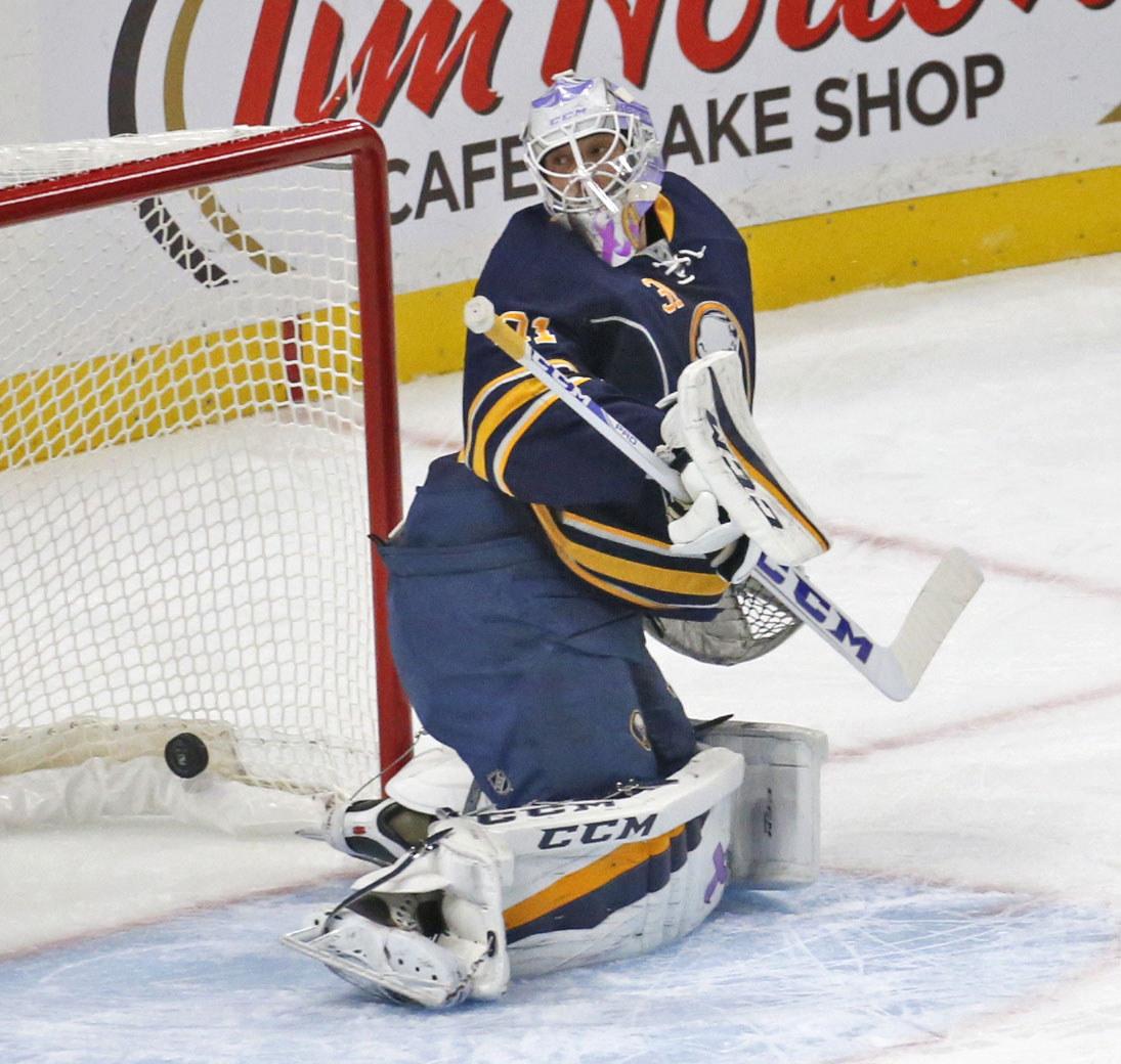 Buffalo's goalie Anders Nilsson sees Jason Zucker's goal rattling around in the net. (Robert Kirkham/Buffalo News)