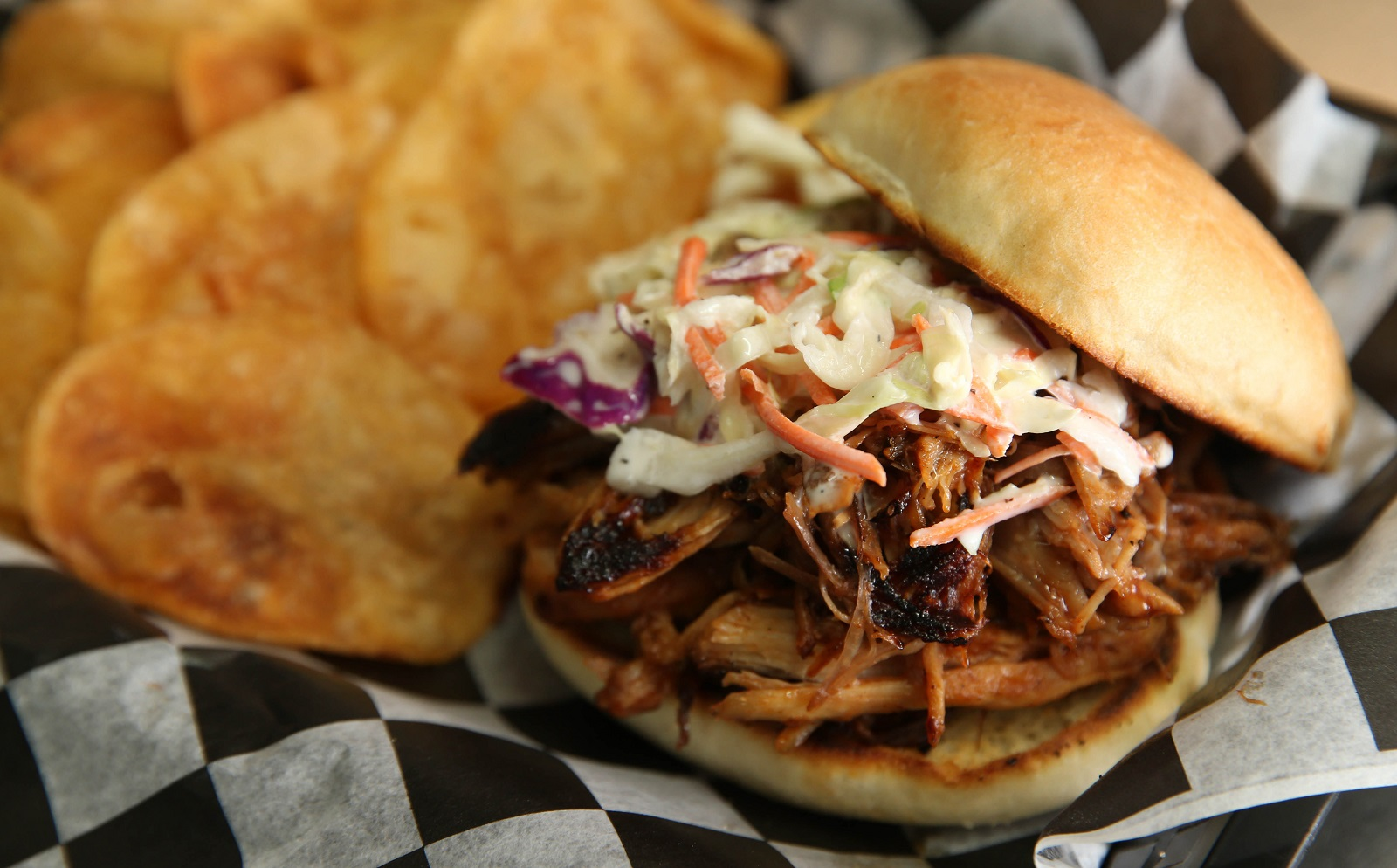 R&R BBQ's pulled pork sandwich with housemade chips. (Sharon Cantillon/Buffalo News)