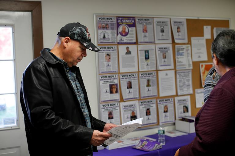 JC Seneca, who is running for president of the Seneca Nation against the powerful Seneca Party, which he left to form a new party, One Nation, in 2014, looks over the sample ballot at his campaign office, Friday, Oct. 28, 2016. (Derek Gee/Buffalo News)
