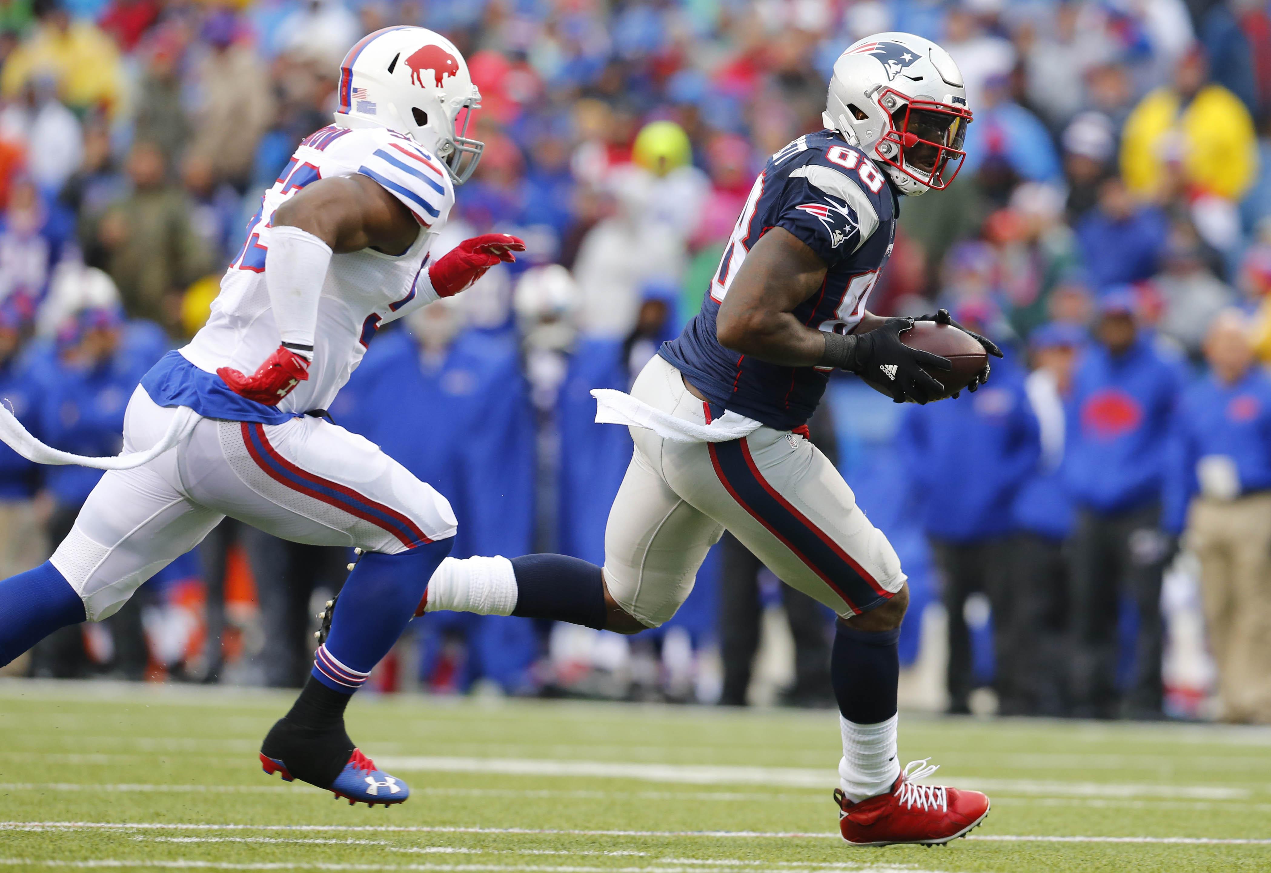 New England Patriots tight end Martellus Bennett (88) runs away from Buffalo Bills linebacker Zach Brown (53) during the third quarter at New Era Field in Orchard Park Sunday, Oct. 30, 2016.   (Mark Mulville/Buffalo News)